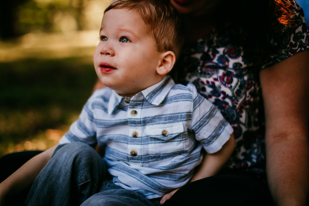 little boy in mom's lap in the park | The Hann Family | Hanna Hill Photography | Durham, NC Family photographer