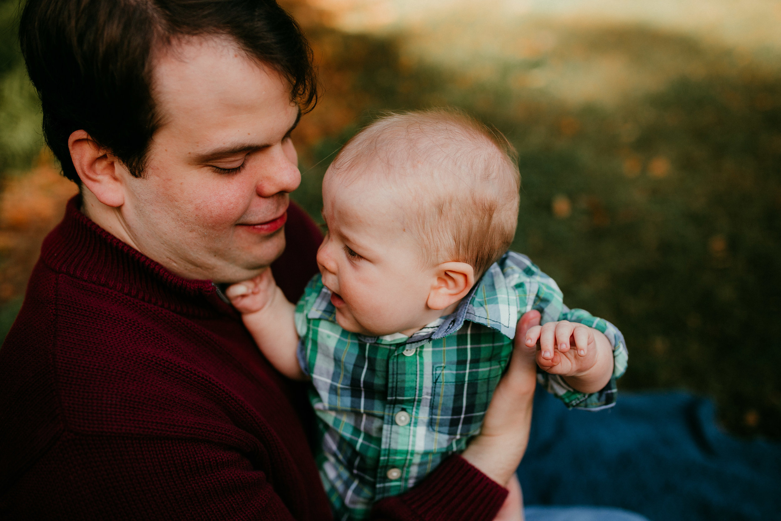 dad looks adoringly at his son during a family session at Duke Gardens Durham, North Carolina | Hanna Hill Photography | Raleigh birth and family photographer