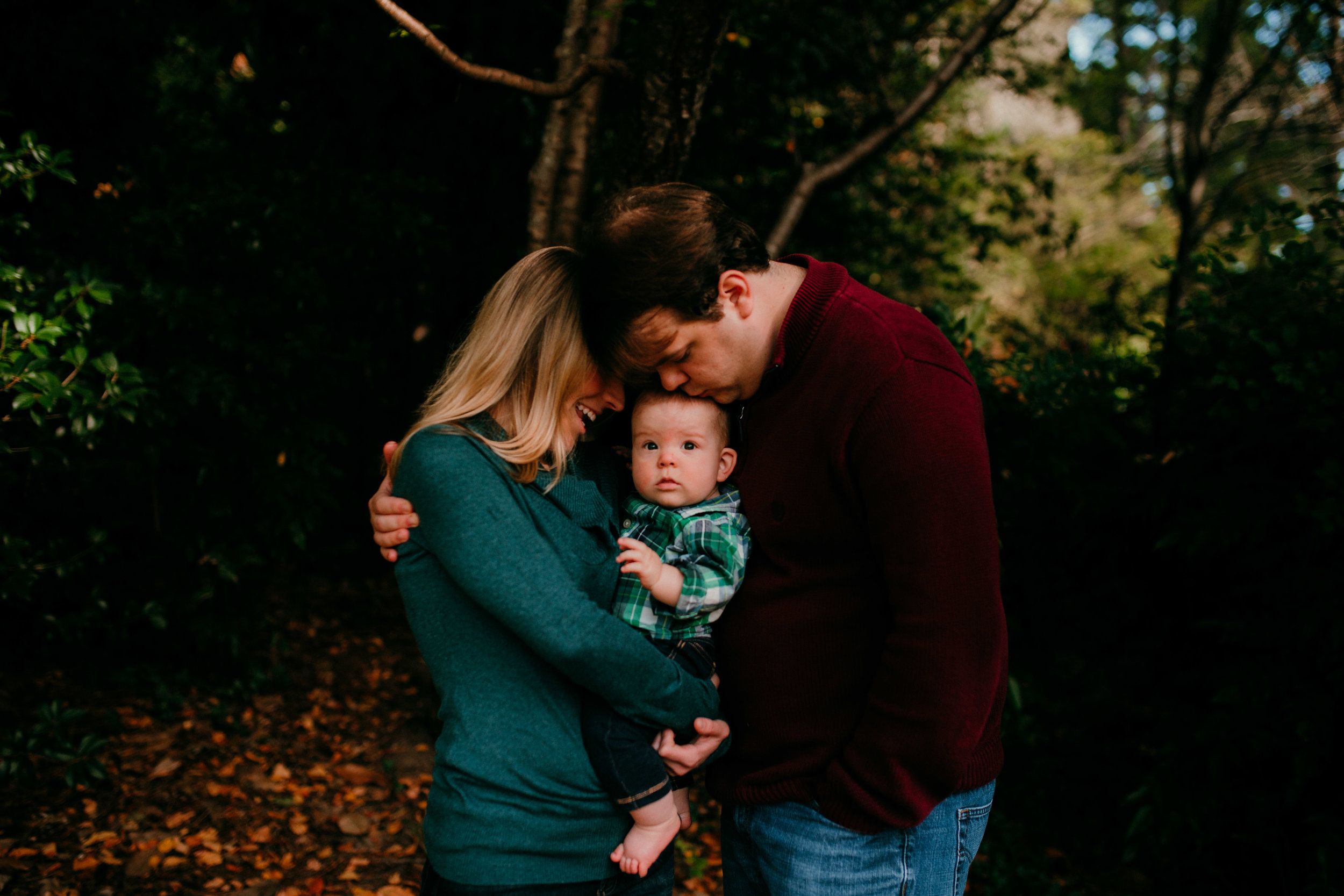 mom and dad love on their little boy during a Fall Family session in Durham North Carolina | Hanna Hill Photography | Raleigh Birth and Family Photographer
