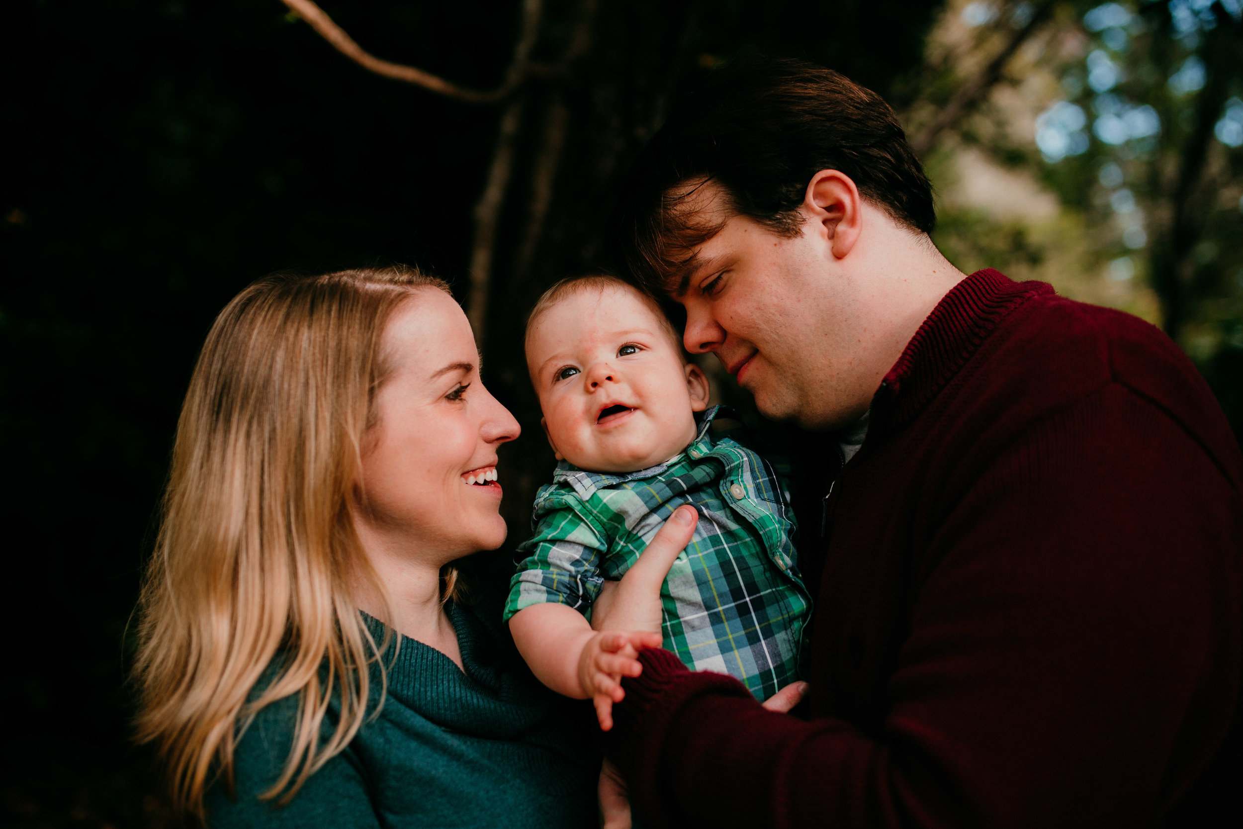 mom dad and baby having a sweet snuggle moment at the Duke Gardens during a Fall Family Session in Durham, North Carolina | Hanna Hill Photography | Raleigh birth and family photographer