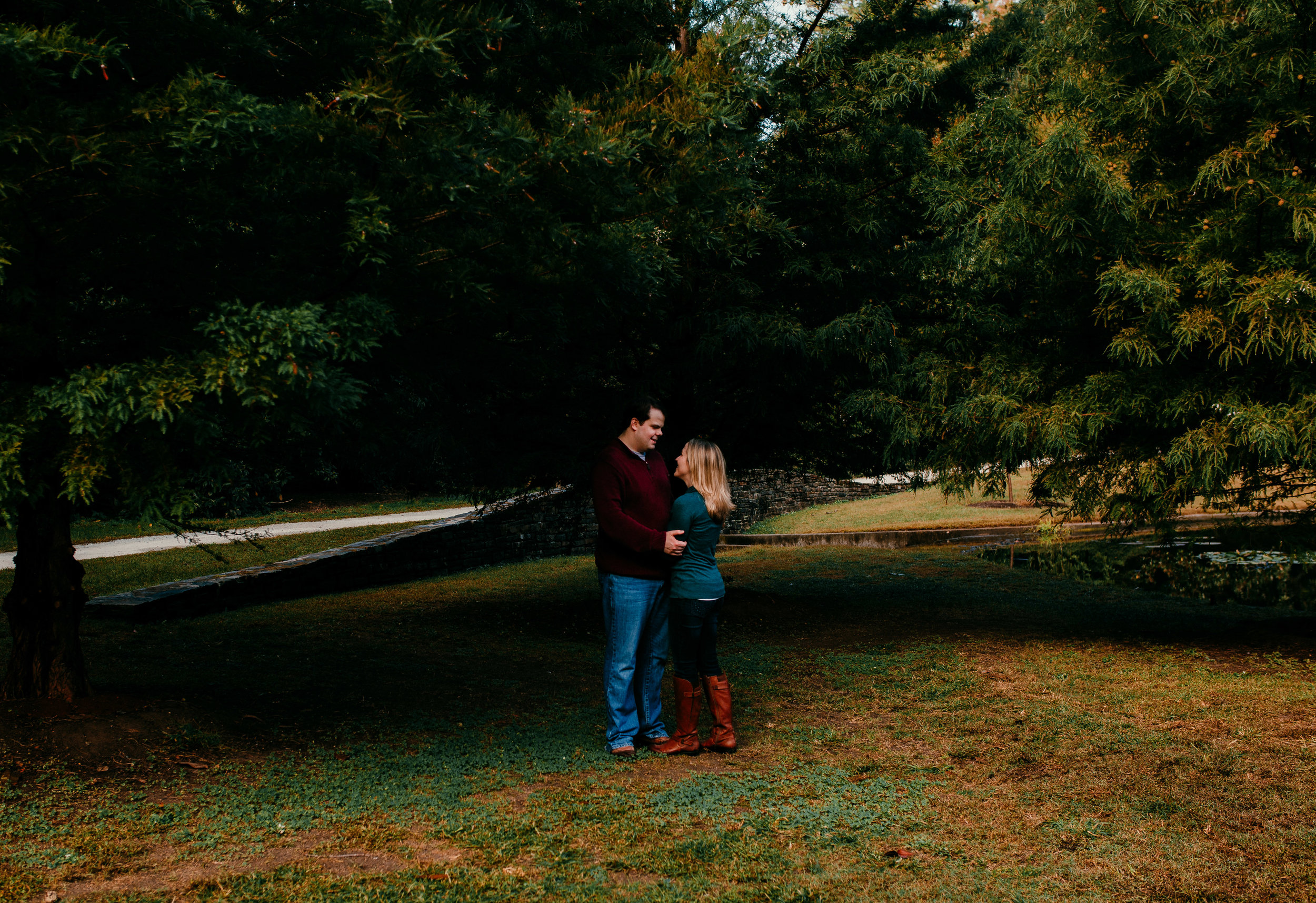 mom and dad have a moment alone during their fall family session at Duke gardens in Durham, North Carolina | Hanna Hill Photography | Raleigh birth and family photographer