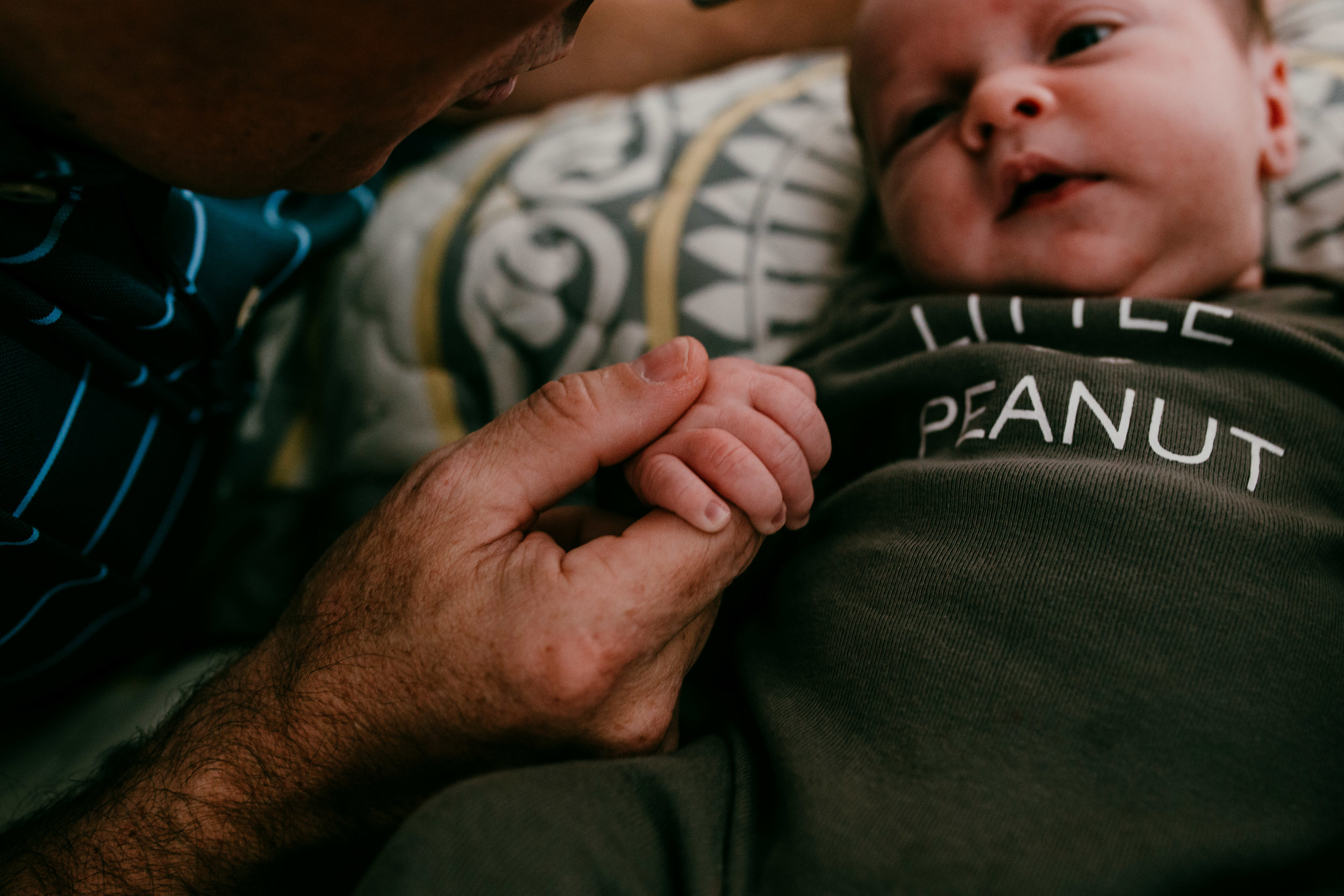 sweet moment with Dady and baby hands during an in home newborn session | Hanna Hill Photography | Raleigh birth family newborn photographer