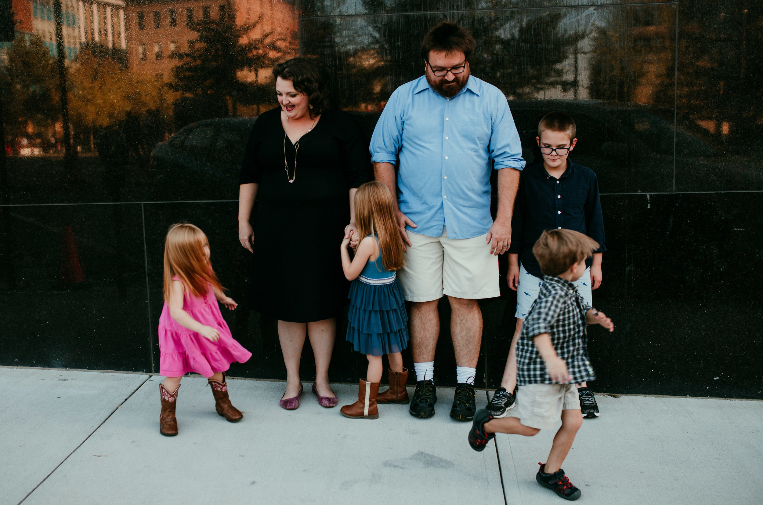family enjoys life in downtown Durham during their family photo session | Hanna Hill Photography | Raleigh birth and family photographer