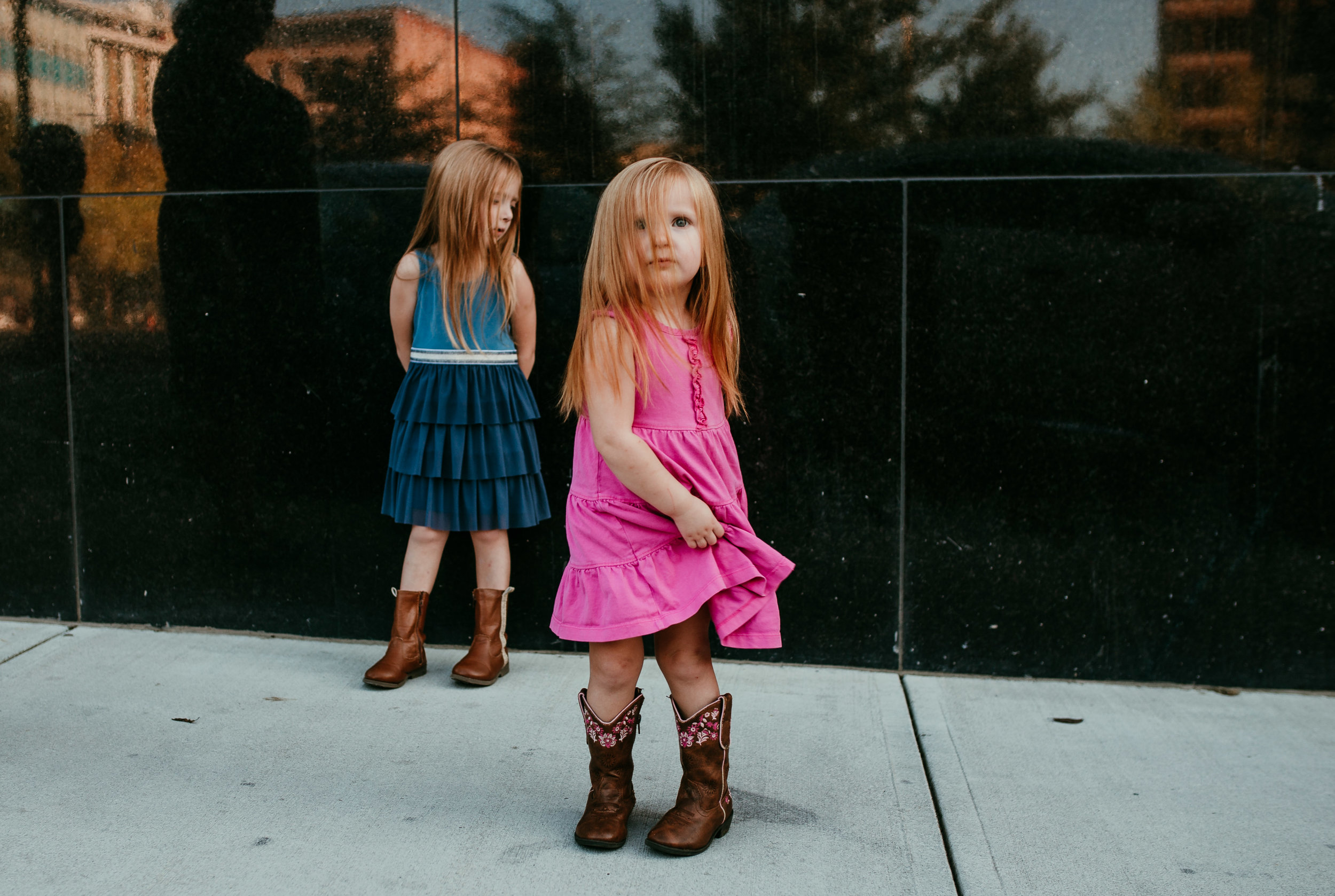 sweet little girls dancing on the street in Downton durham family session | Hanna Hill photography | Raleigh birth and family photographer