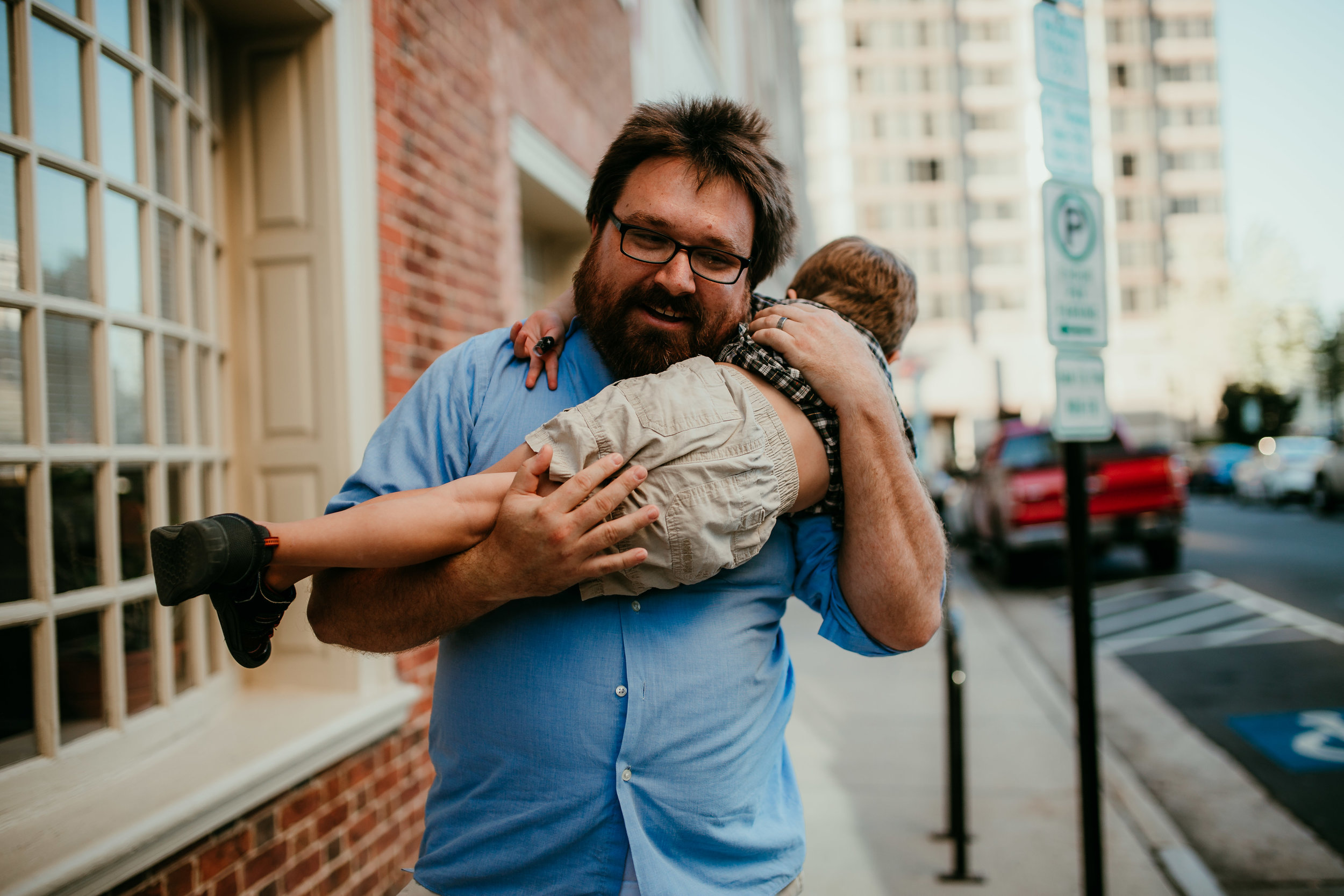 a sweet dad moment during their downtown durham, NC family photography session | Hanna Hill Photography | Raleigh birth and family photographer