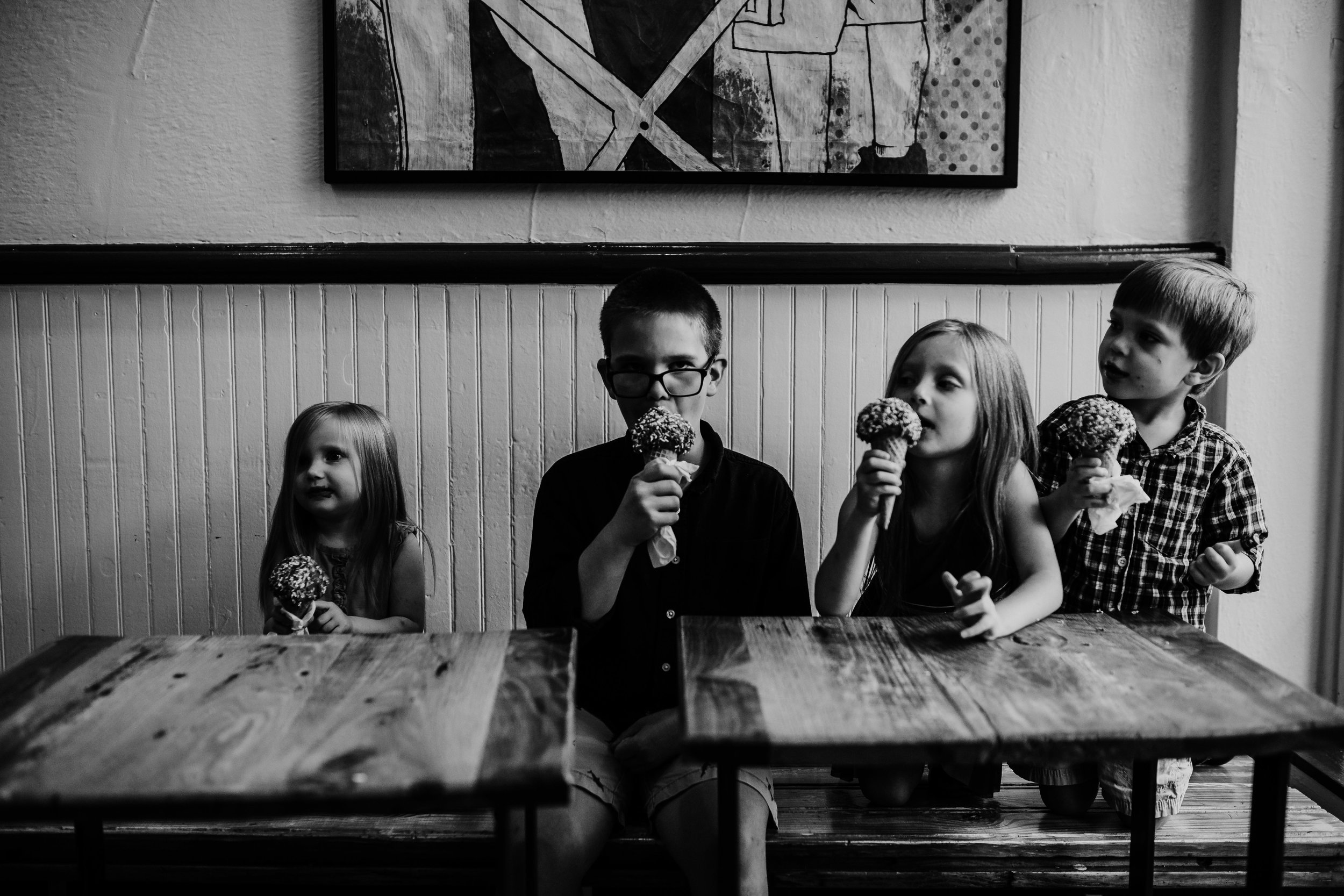 the kids enjoy their ice cream cones at the parlous ice cream shop in downtown durham, NC | Hanna Hill Photography | Raleigh birth and family photographer