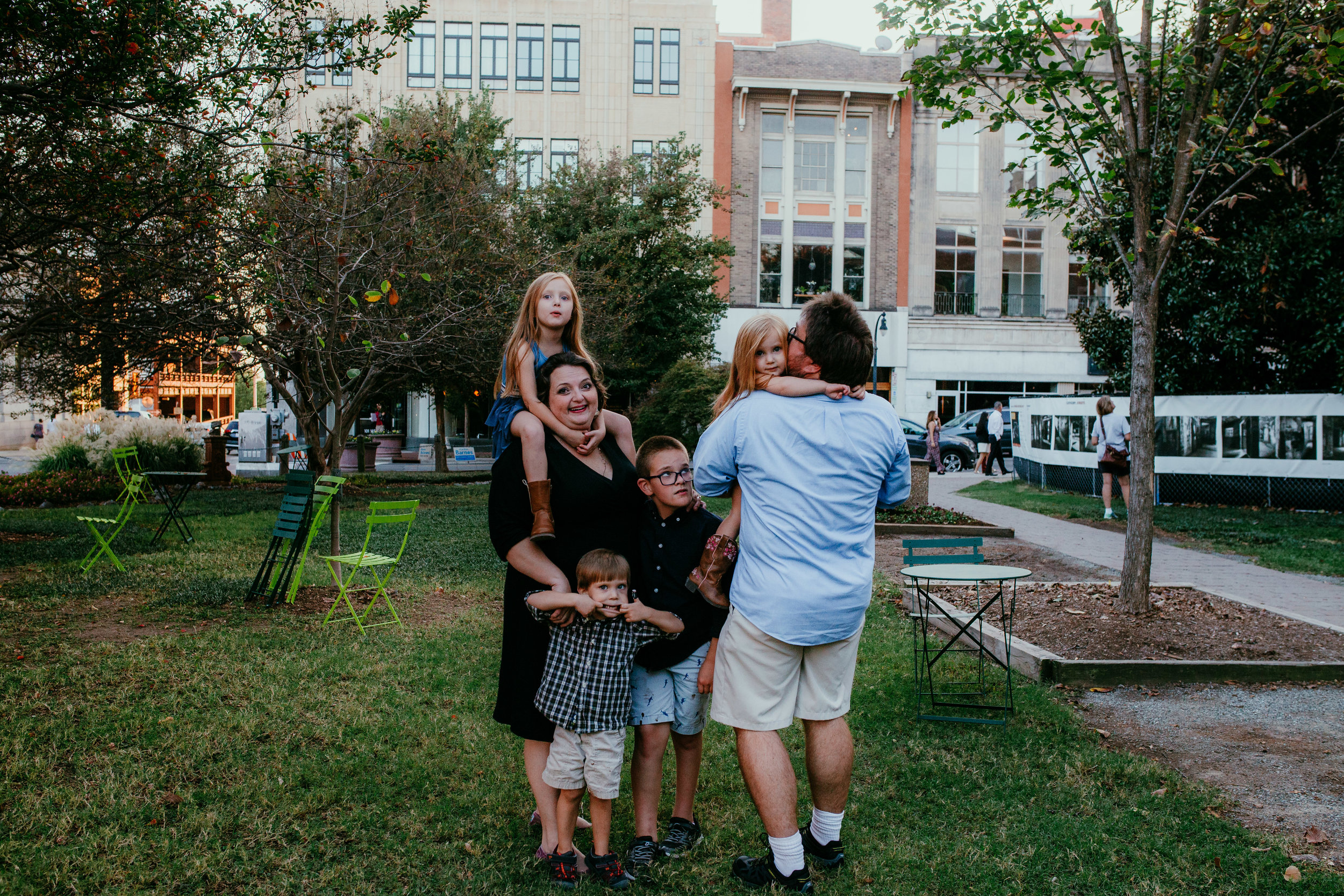 sweet family moment at the community park during a downtown durham, NC family photography session | hanna Hill photography | Raleigh birth and family photographer