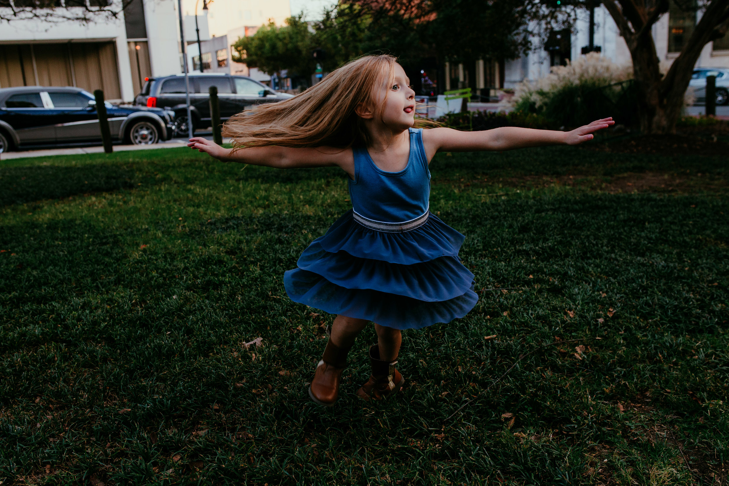 little girl spinning at the community garden during a downtown durham, NC family photography session | hanna Hill photography | Raleigh birth and family photographer
