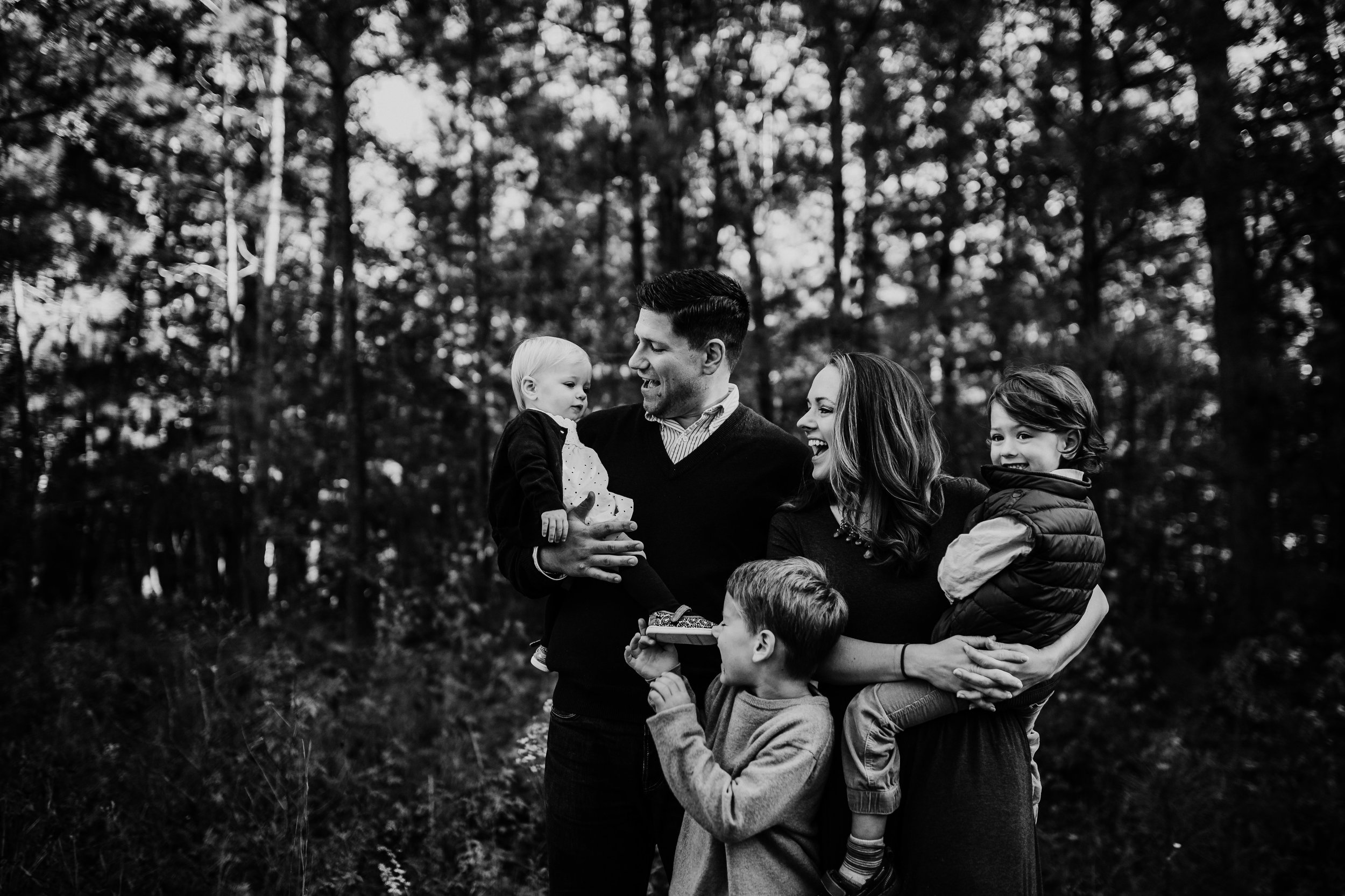 a sweet happy family moment trying to get the littlest to laugh | Durham, NC Family Photography | Hannahill photography | Brumley nature Preserve