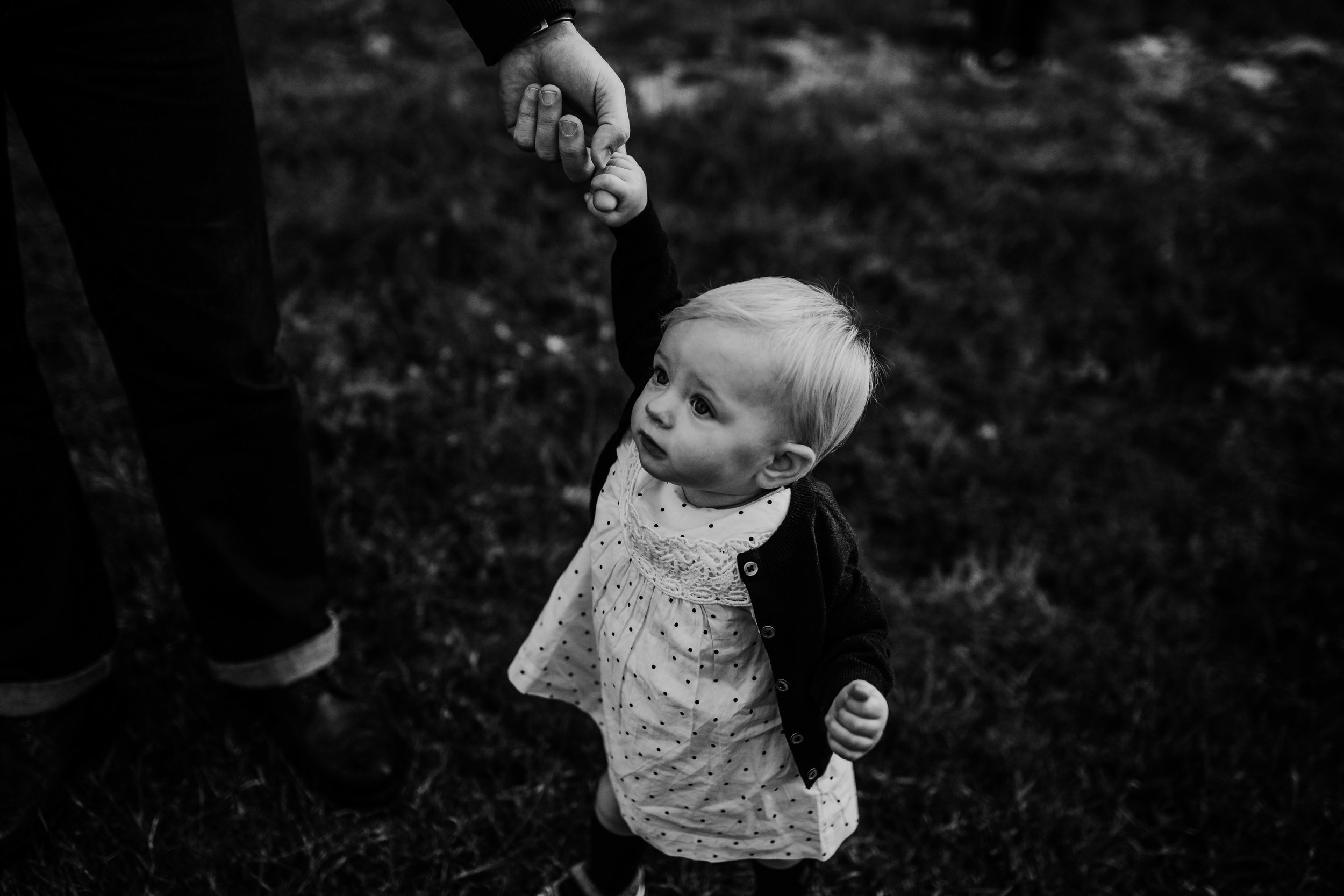 little girl holding dad finger during the family portrait session | Durham, NC Family Photography | Hannahill photography | Brumley nature Preserve