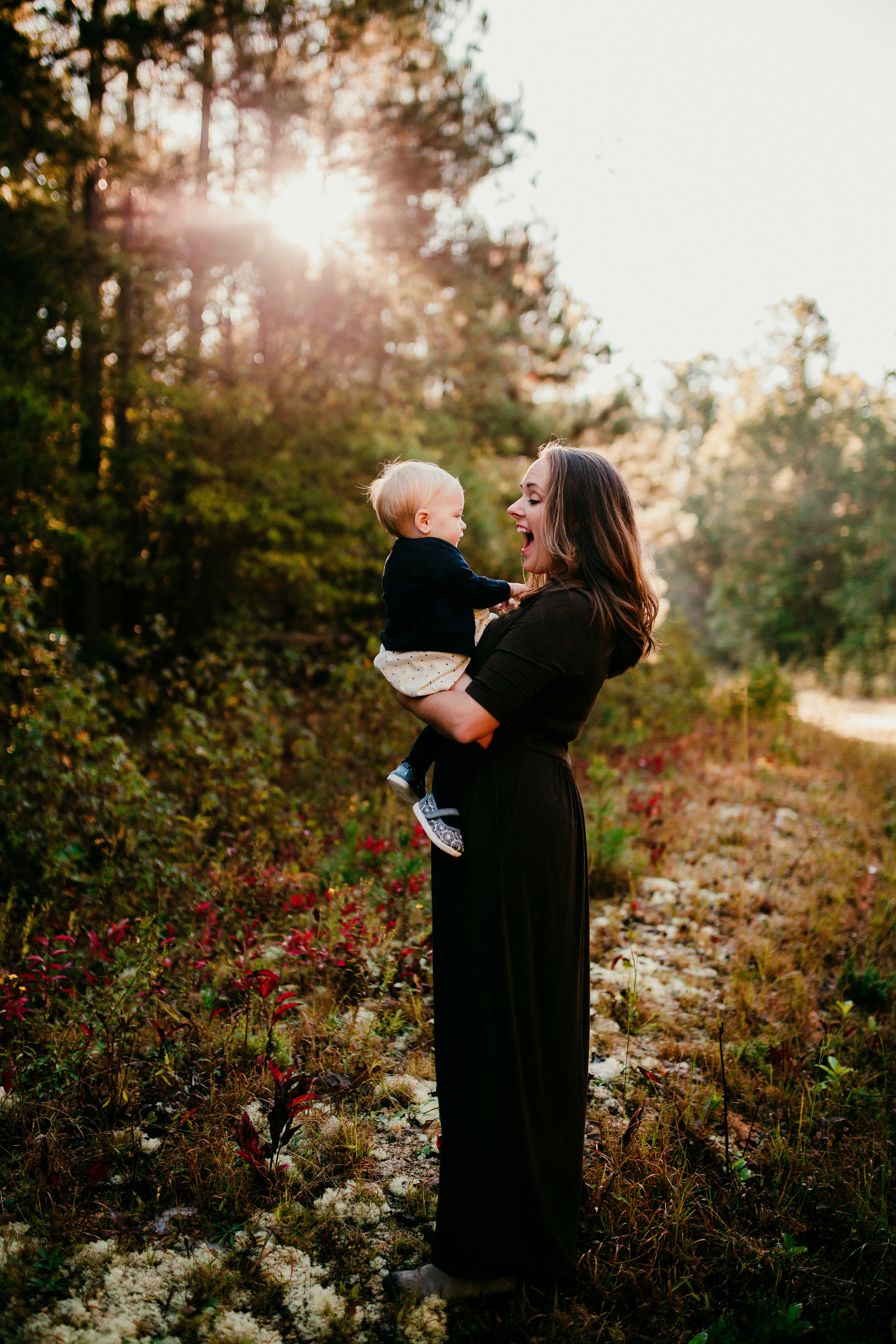 a sweet mom and daughter moment in front of the sunflare | Durham, NC Family Photography | Hannahill photography | Brumley nature Preserve