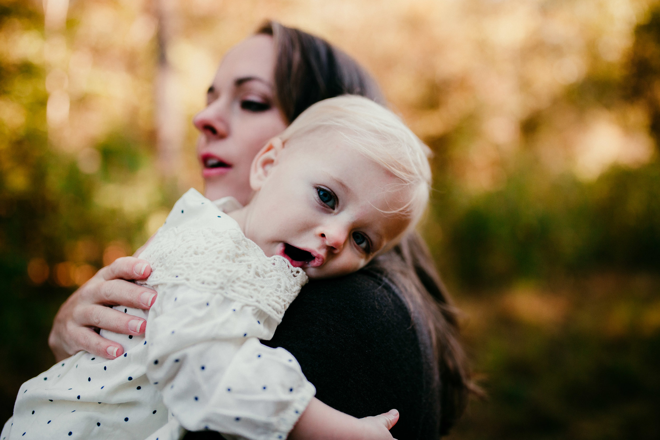 child yawns in moms arms| Durham, NC Family Photography | Hannahill photography | Brumley nature Preserve