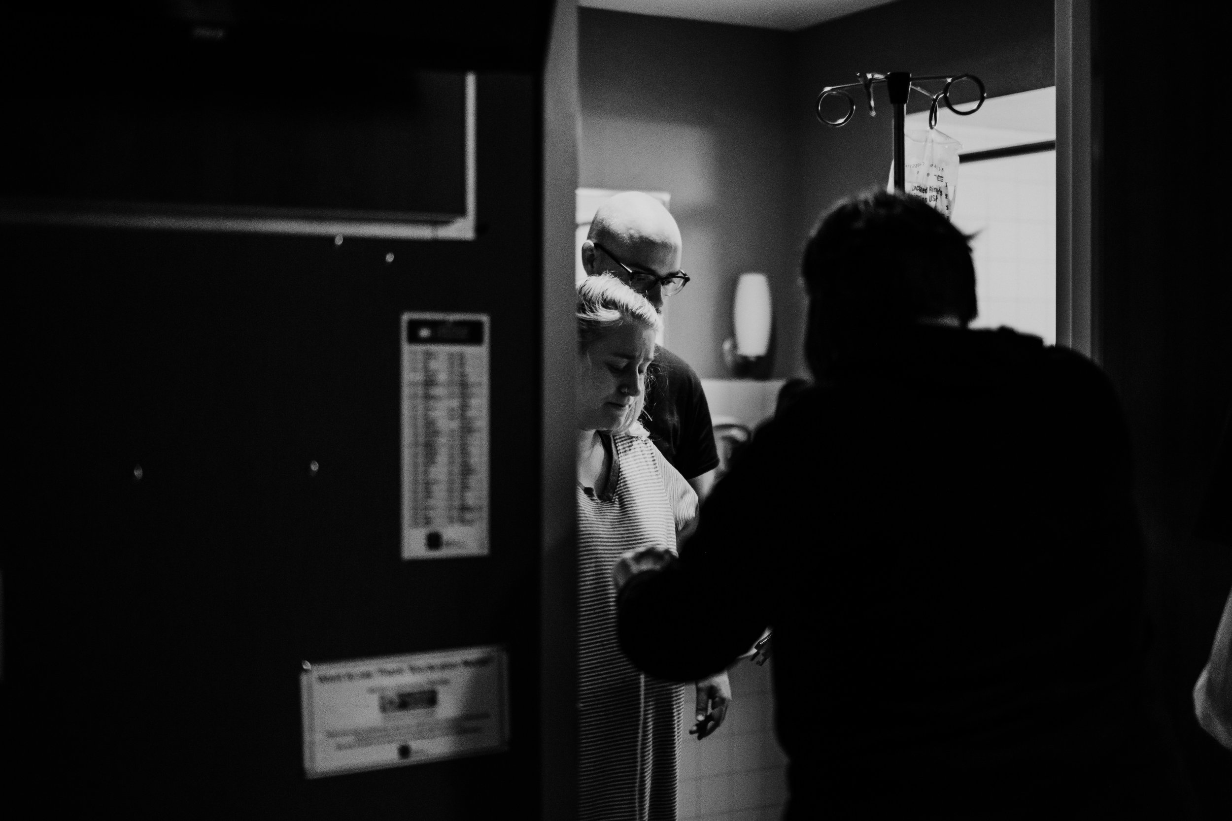 Mom uses the restroom to help keep things moving during labor hospital birth story | Titus L Birth Story | Hanna Hill Photography | Raleigh Durham Birth and Family Photographer