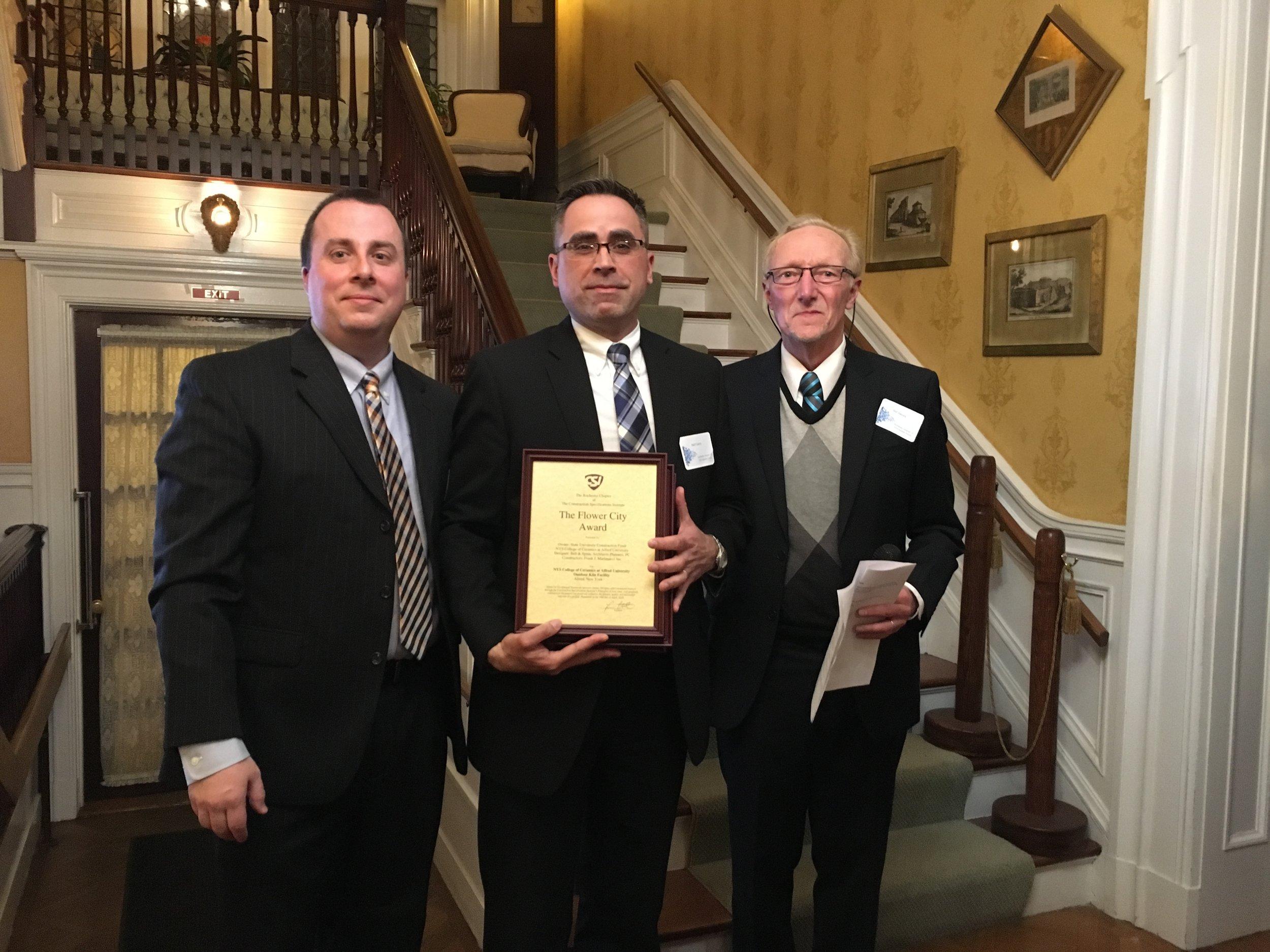 Neil W. Garry, PE, RRC, REWC (center) representing Bell & Spina at CSI Rochester award ceremony.