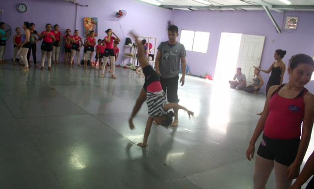 Yolani doing one handed cartwheel