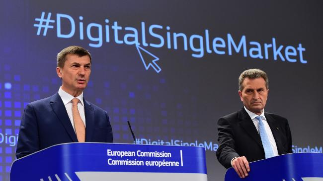 EU Digital Single Market Commissioner Andrus Ansip (L) with EU Digital Economy and Society Commissioner G ü nther Oettinger (R).