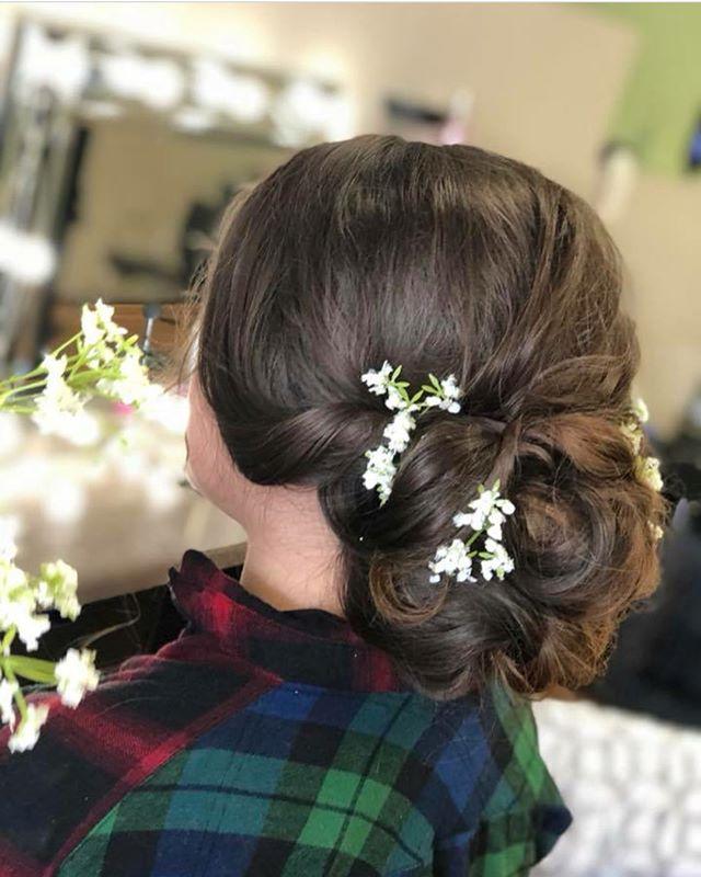 Stunning updo by Hair Artist Nickie  #chignon #updo #babysbreath #prom #hairstyle #create #emzysalonandspa
