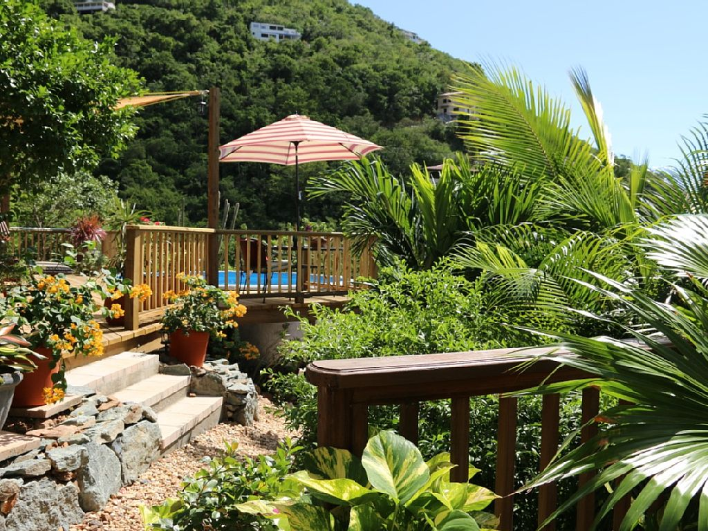 A lush tropical setting surrounds the one bedroom villa and private pool.