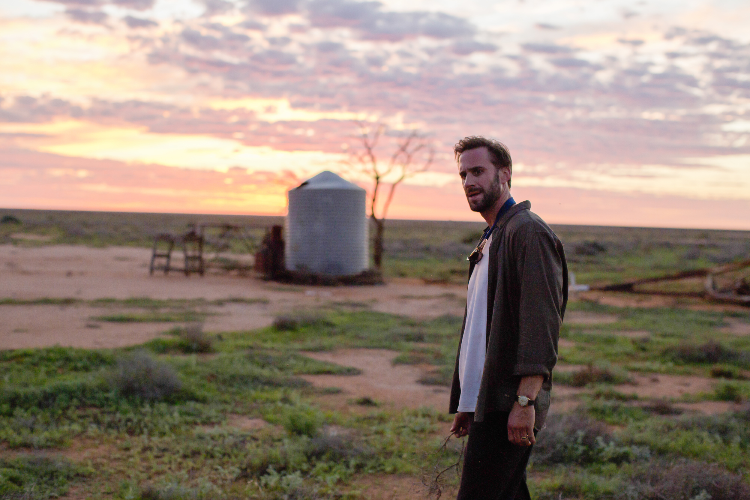 SL41_Matthew Parker (Joseph Fiennes)_Holds Branch In Desert.jpg