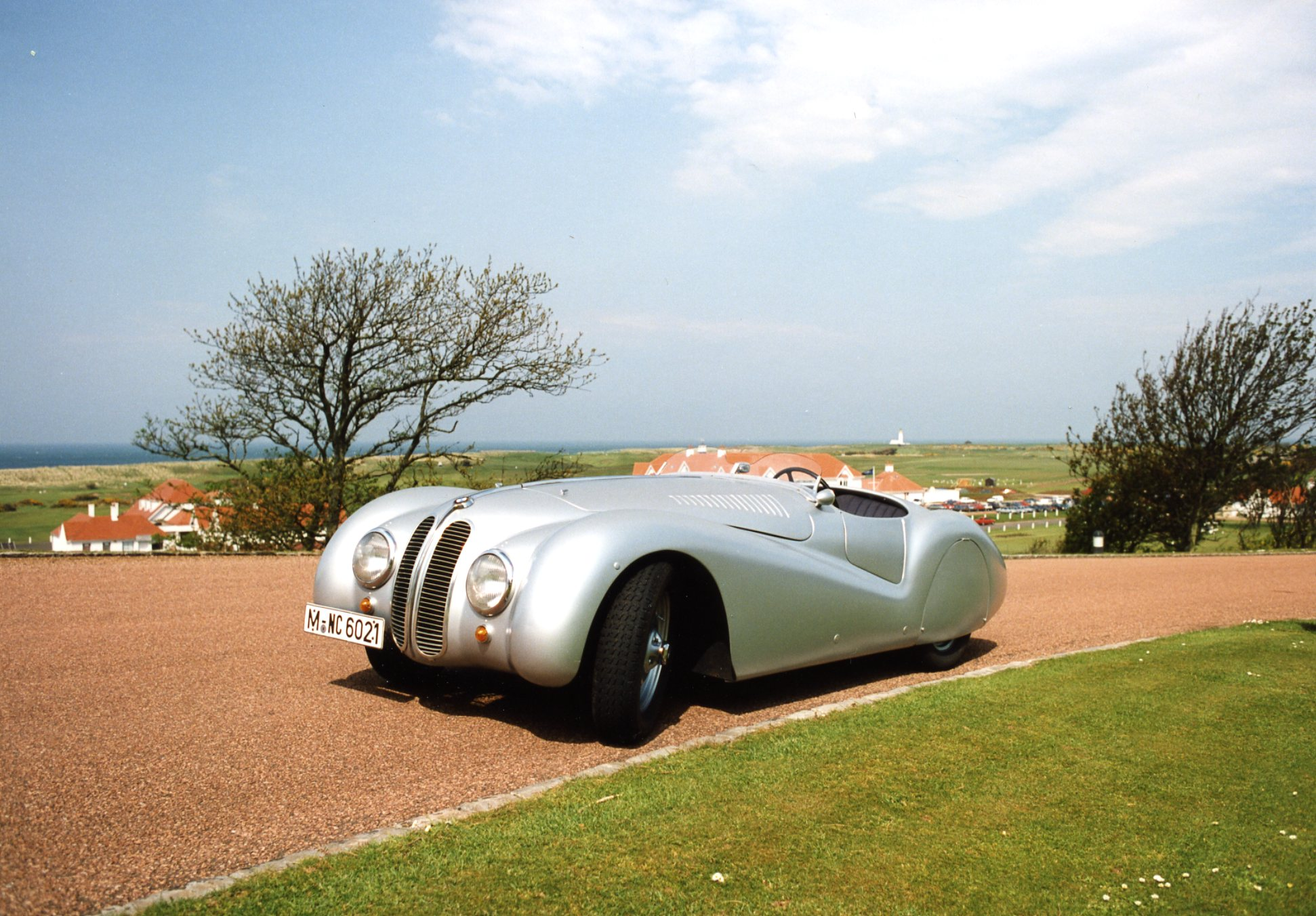 BMW reinstated the kidney-shaped grille during restoration of the lightweight aluminium body. Frazer-Nash had a chrome curved appliqué one on its prototype. In the distance the renovated lighthouse marks the course's halfway point with seating for guests to enjoy Ailsa Craig.