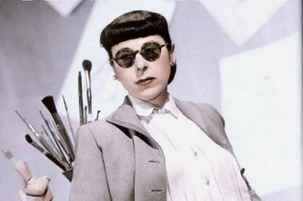 Edith Head wearing her trademark round glasses