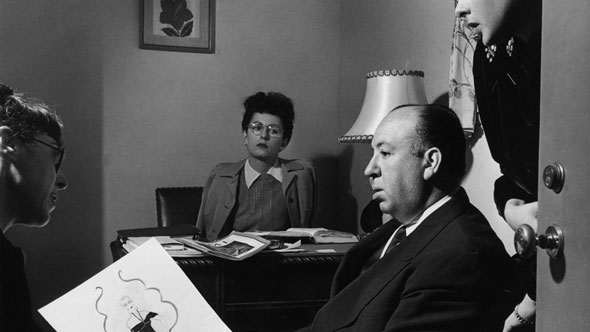 Here is Edith Head collaborating with Alfred Hitchcock