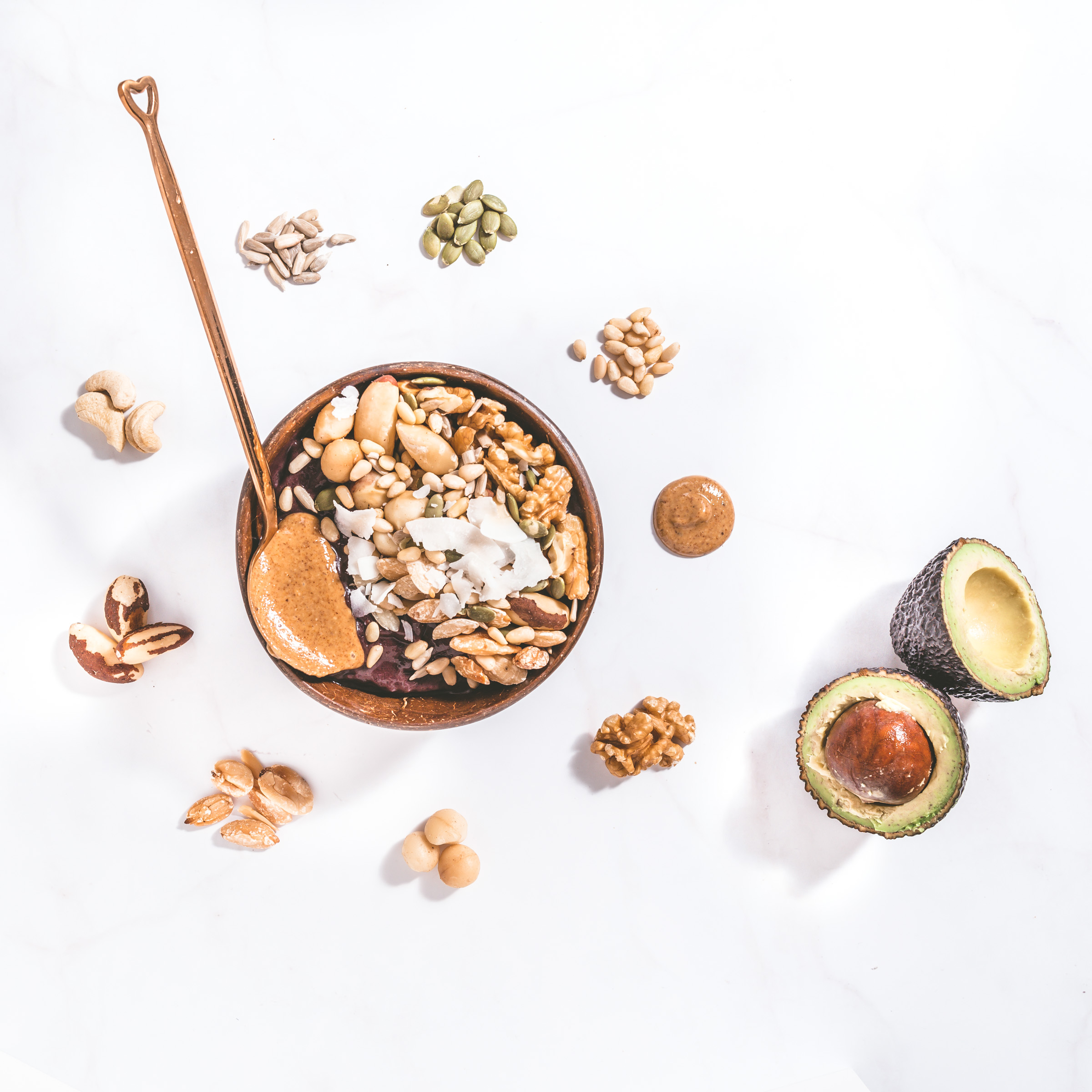 Keto Açaí Bowl blended with Poppy & Co. Organic Açaí Berry pulp and avocado, topped with a mixture of healthy nuts and seeds, finished with a spoonful of creamy almond butter