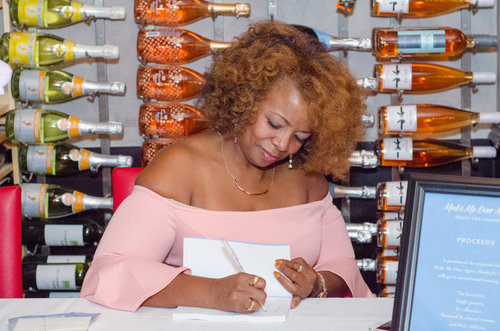 Book signing at book release party