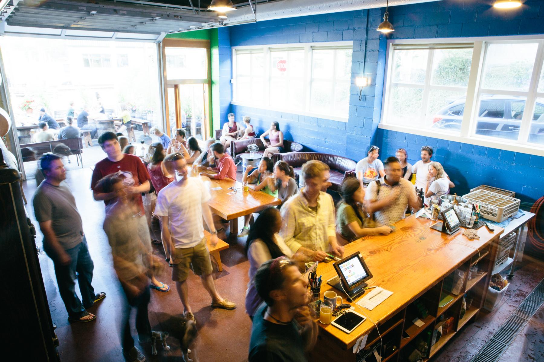 Customers looking at beer menu board