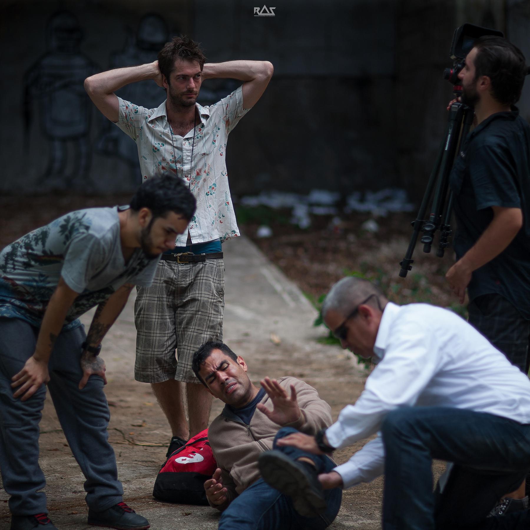 Mark Castro looks pensive as Jesus Reyes la Salle aids J.W. Cortés. Producer/director Michael Biggam shares a moment with producer/DoP David Mondin.