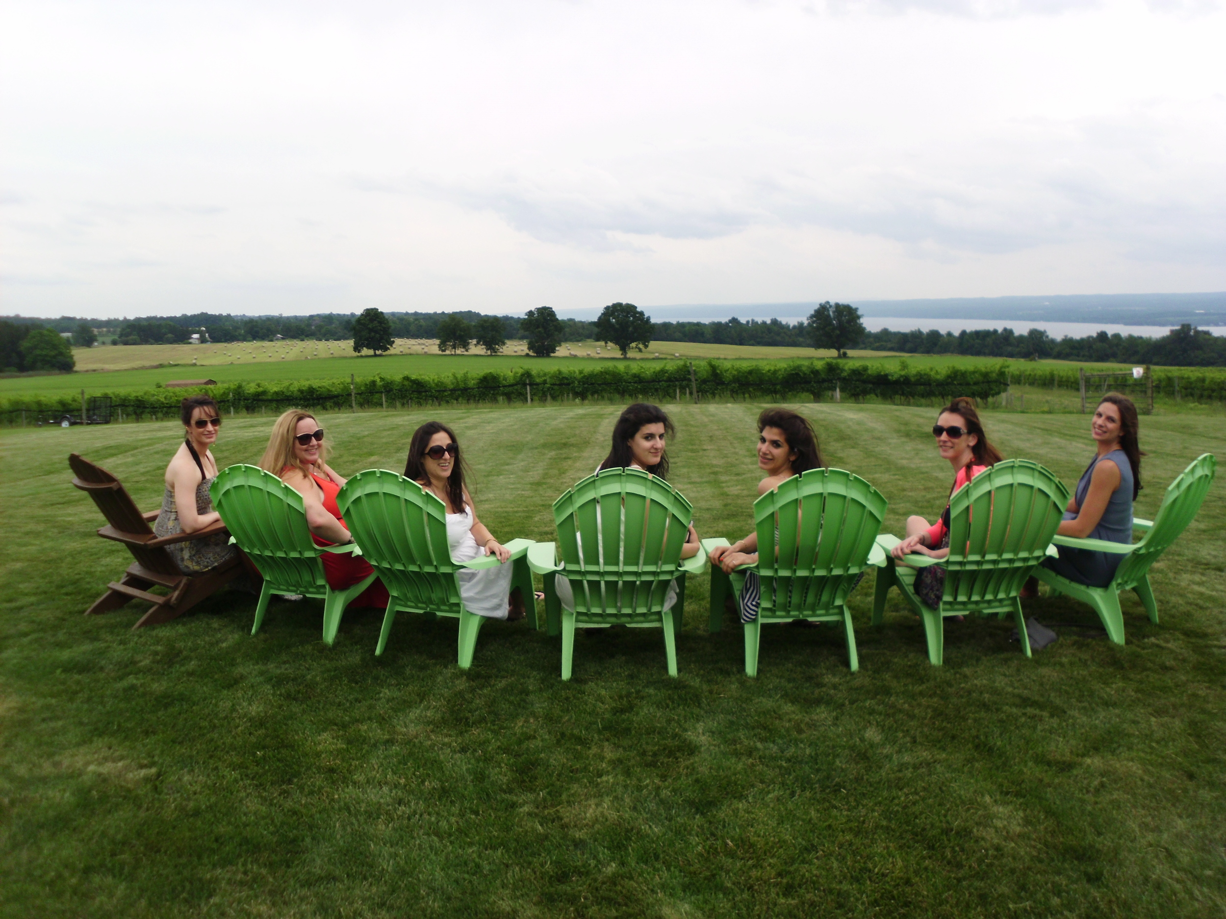 bachelorettes in green chairs with vineyard.JPG