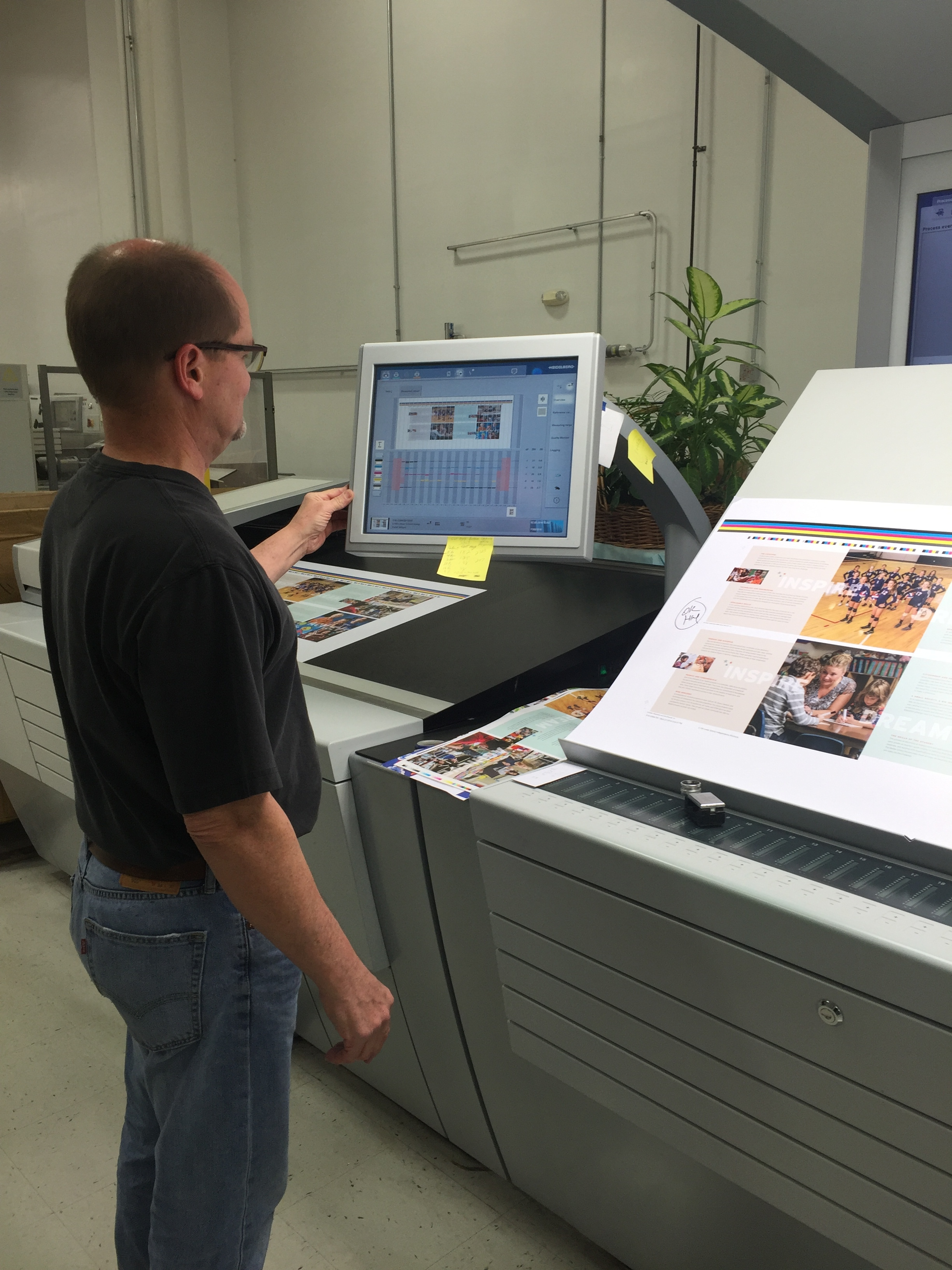 Mike Bandomer, the pressman from Brilliant Graphics, is supervising the press run. For those of you who have never seen the printing process before, this is what the control console at a printing press looks like!