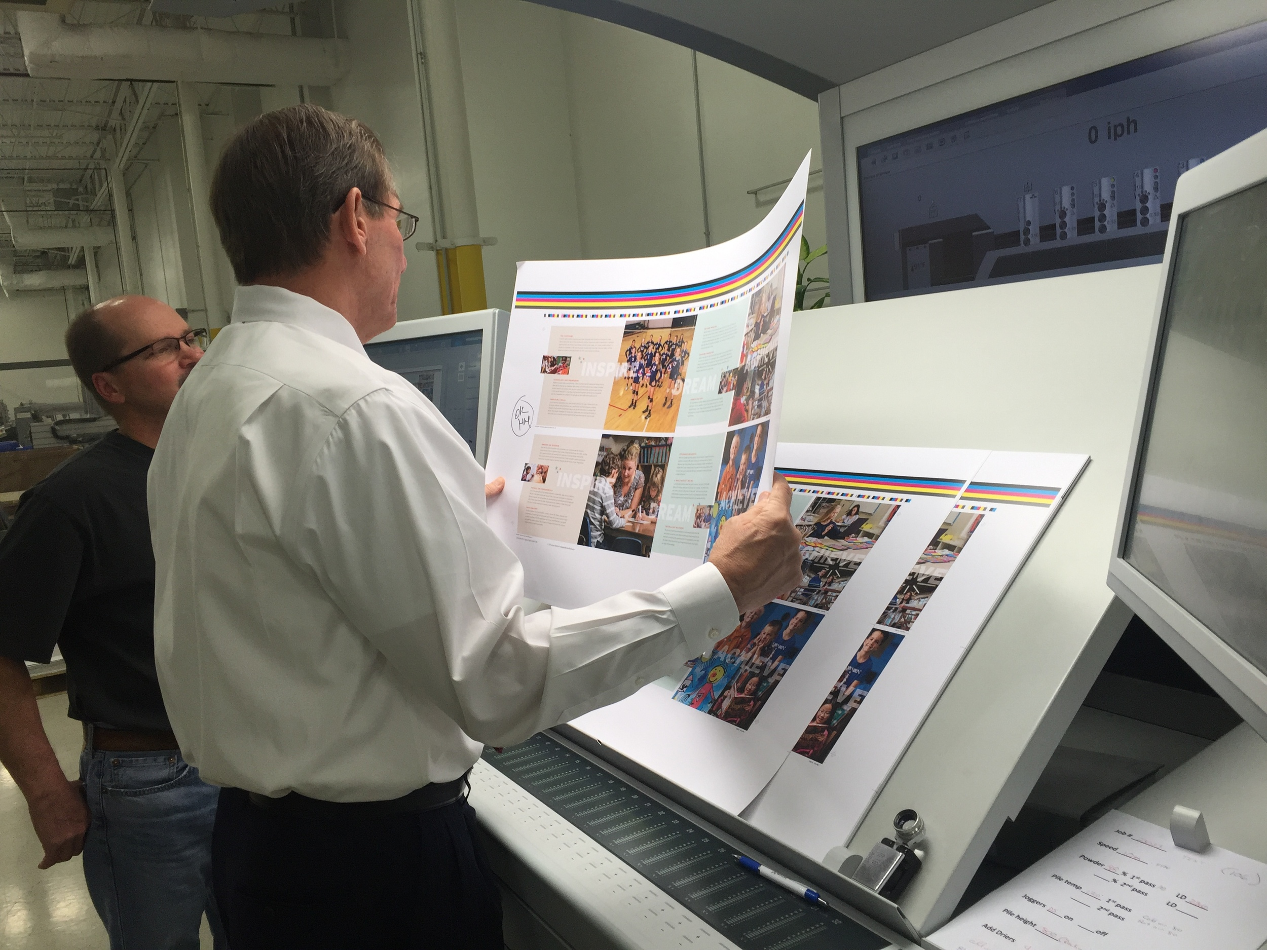 Mike again, seen here consulting with Harold Hepler, our amazing print rep and incredible printing expert.