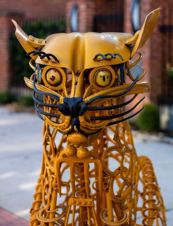 "You'll find the ""Yellow Farm Cat"" sculpture located on the corner of W. Gay Ave. and N. George St."
