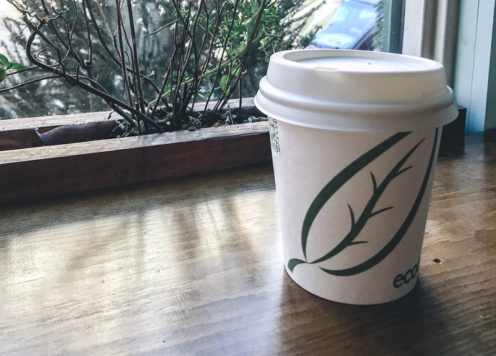 Enjoy coffee from a compostable cup at Molly's Courtyard Café.