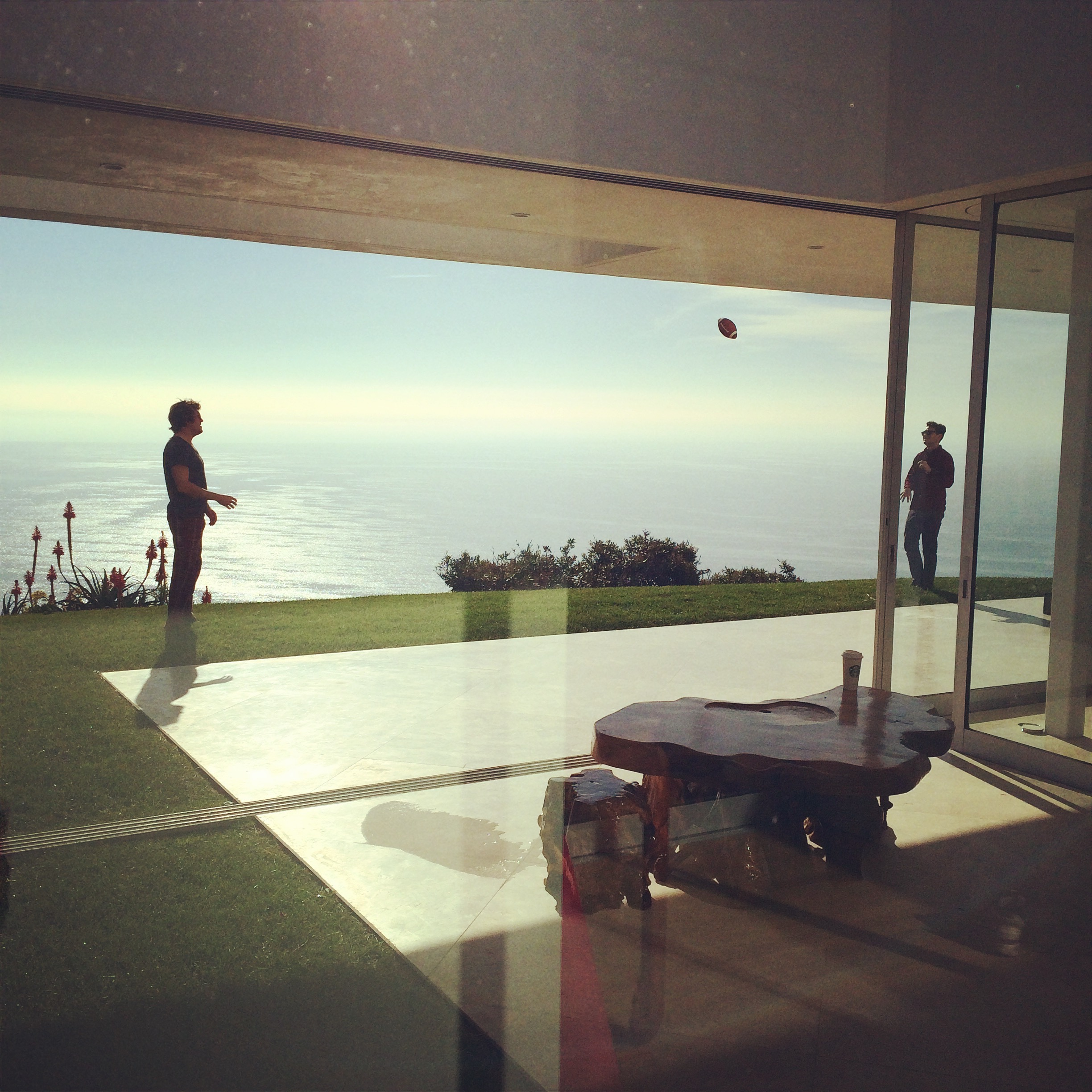 Kai and I tossing the pigskin in front of the Malibu house. Photo by Lara G.