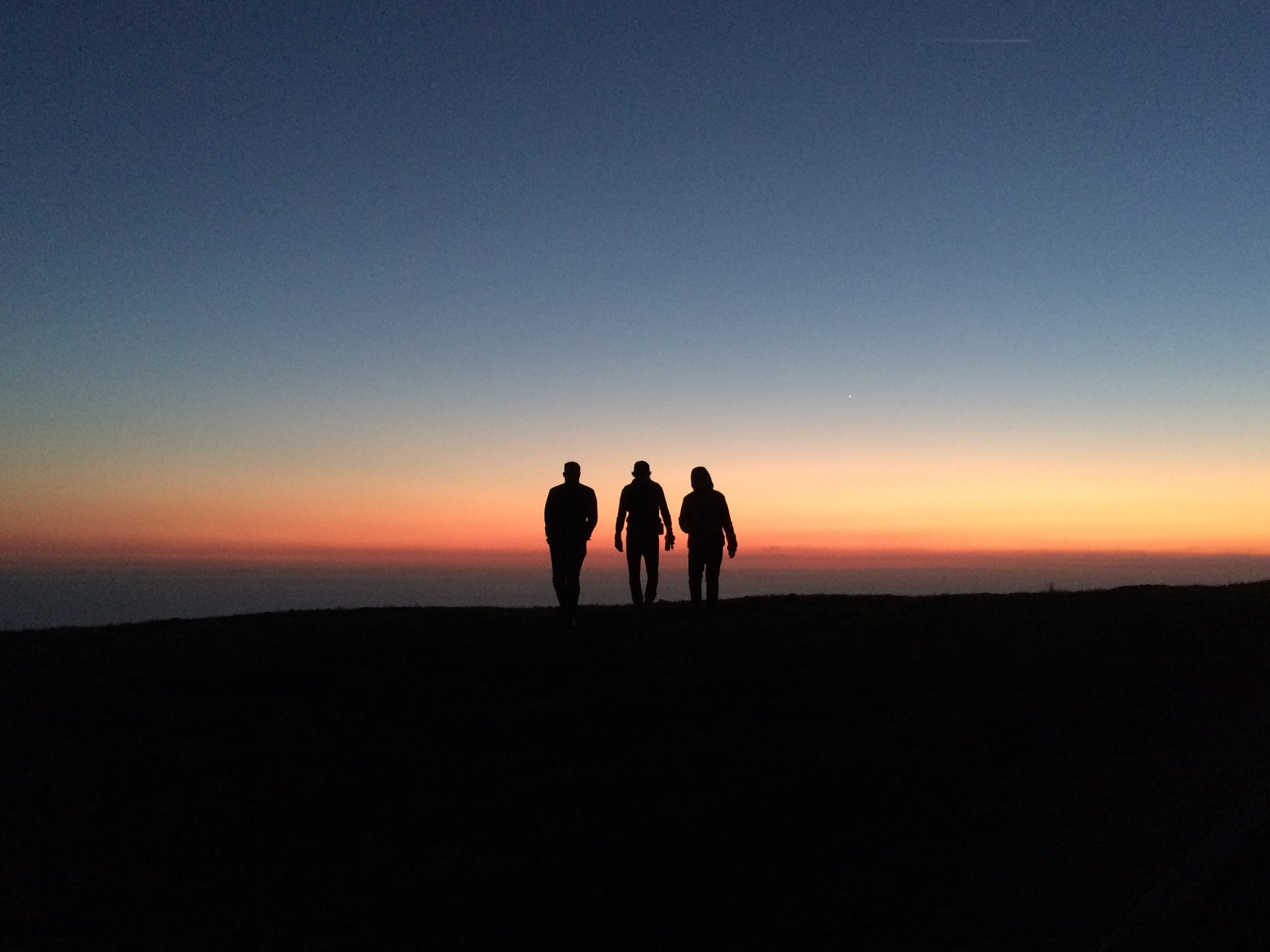 Sunset walk back from Kai's Peak in Malibu. Robbie, Kai, me. Photo by Lara G.