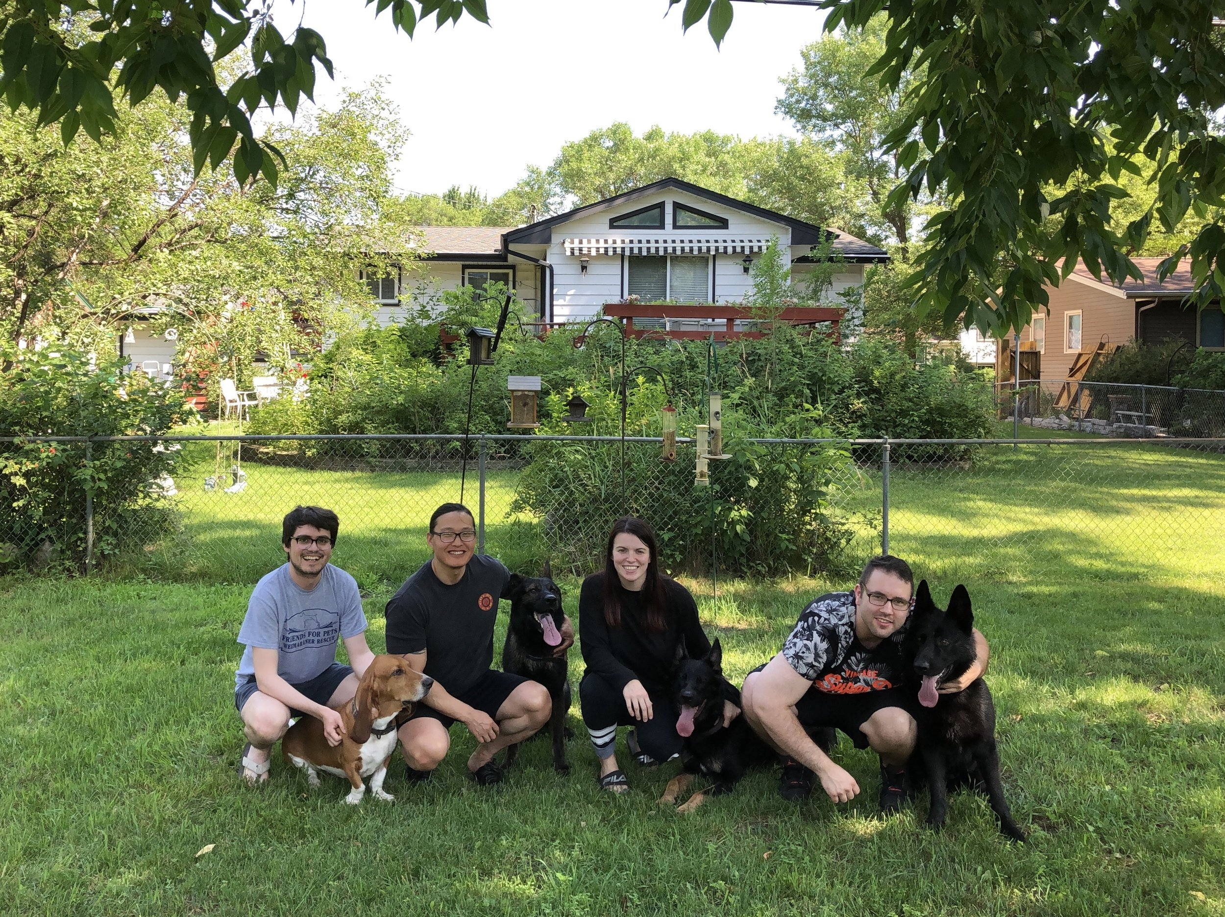 L to R: Me, Koopa the basset hound, my brother Jim, Vulcan the german shepherd, my sister-in-law Mia, Azlo the german shepherd, Mia's brother Eddie, Zeus the german shepherd. Koopa, Vulcan, and Azlo are Jim and Mia's dogs. Zeus is Eddie's dog and also Vulcan's littermate. This pic is technically from Day 11, but the group shot made more sense here.