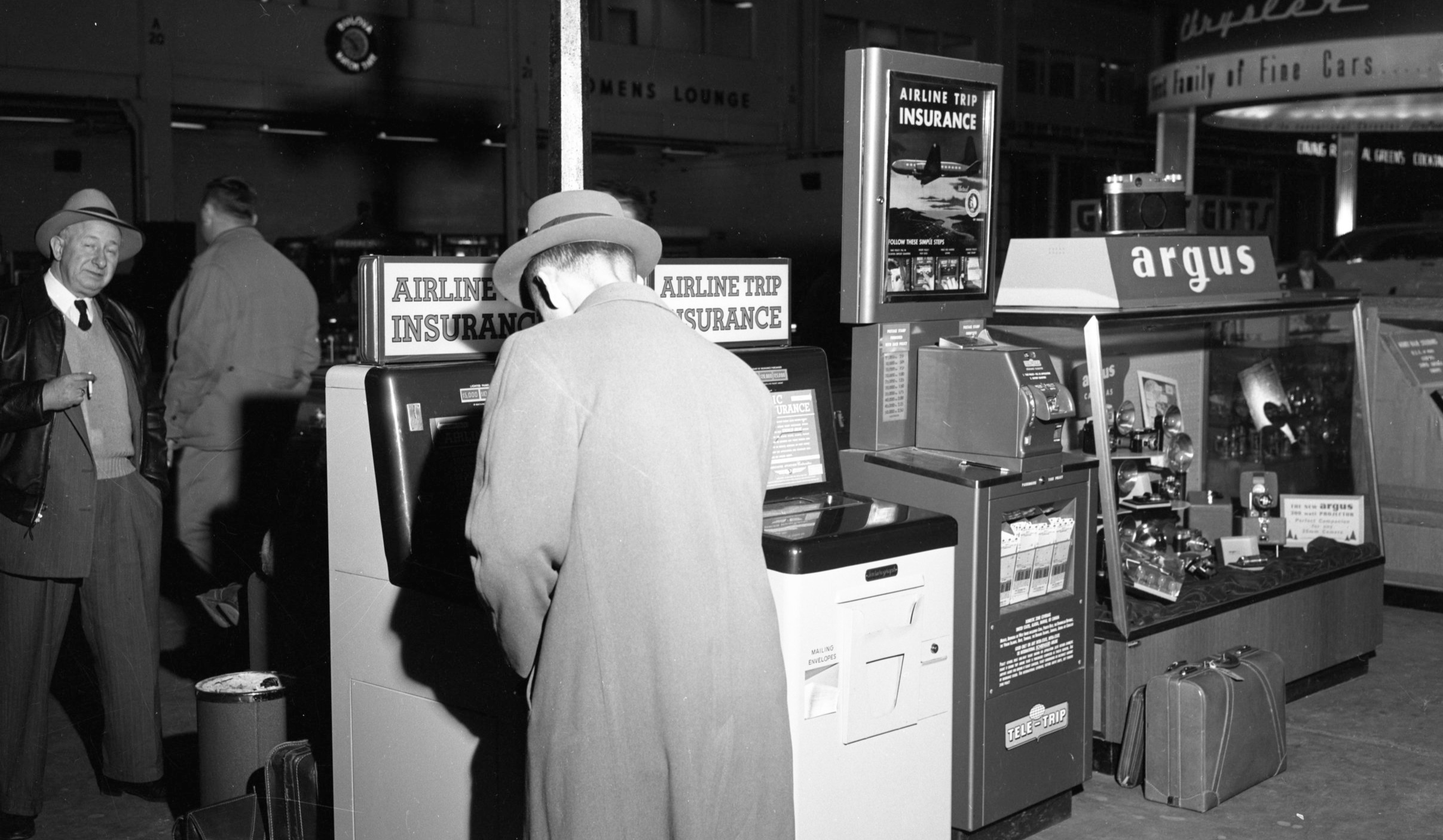 "Travel Insurance Kiosks at Detroit's Willow Run Airport, 1954. Part of the ""Old News"" collection at the Ann Arbor District Library. ( https://aadl.org/N186_0087_007 )"