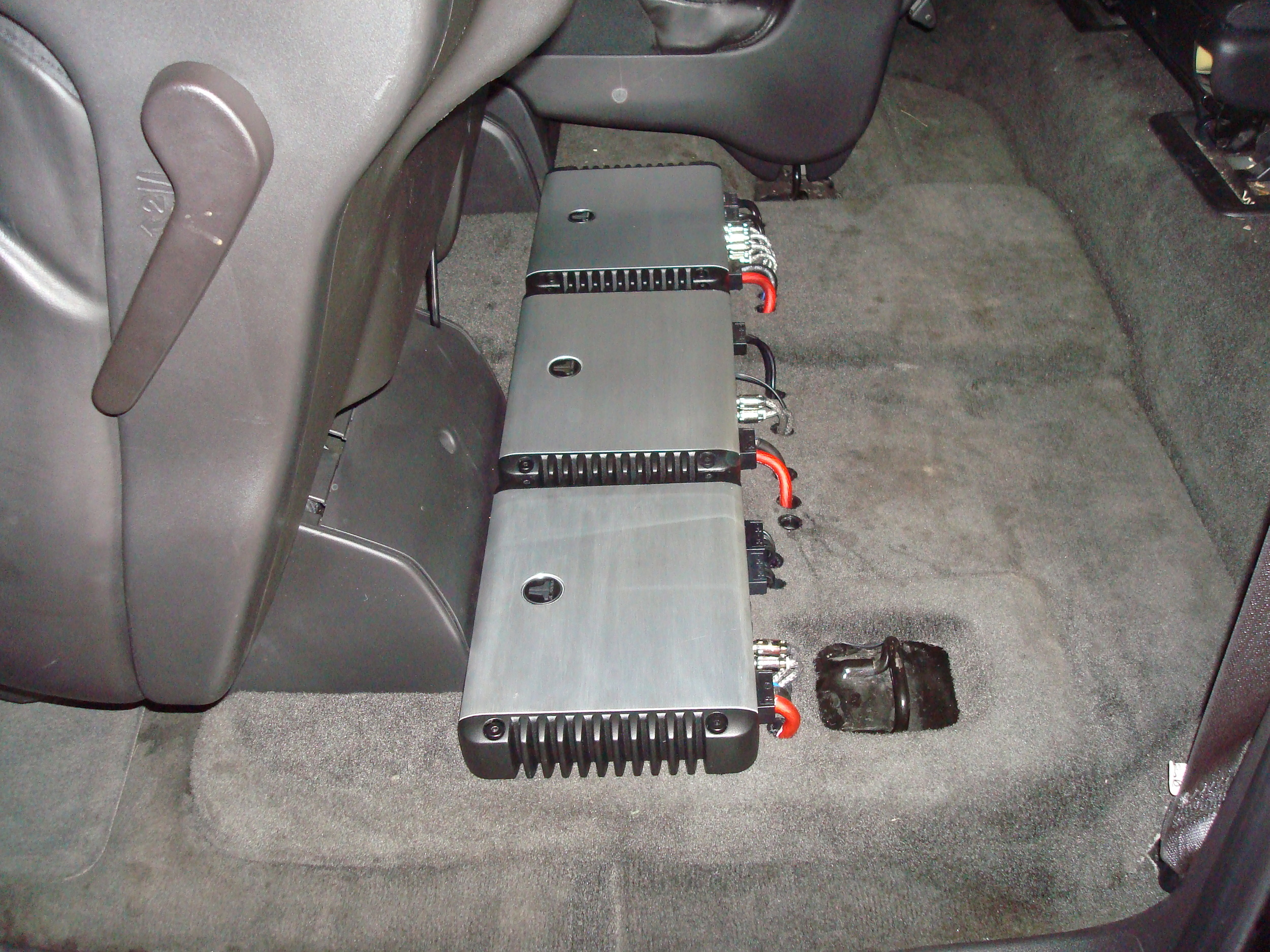2007 Yukon Denali XL - JL Audio HD Amps completely hidden underneath the 2nd row seat