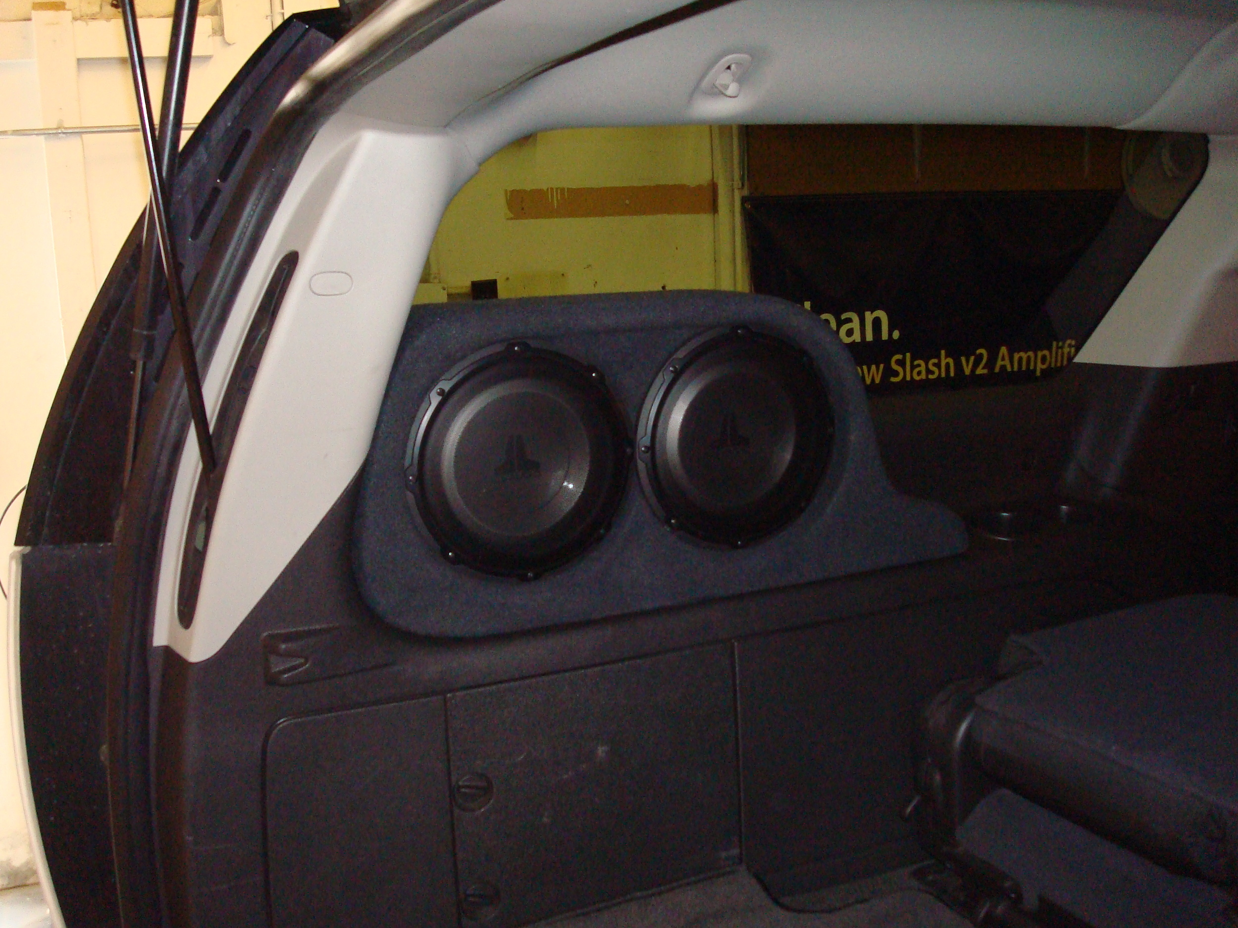 2007 Yukon Denali XL - JL Audio Stealthbox with (2) 10W1 subs.  Keeps the entire cargo area free.