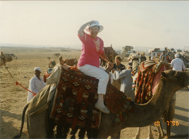 Mother on a camel in Egypt.