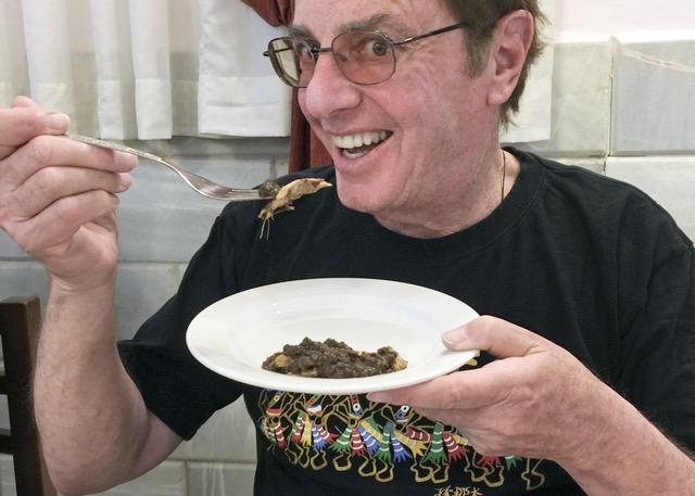 Eating Fasenjan. Photo by Judie Fein.