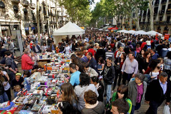 Visitors flock to the annual Sant Jordi Festival in Barcelona, Spain.