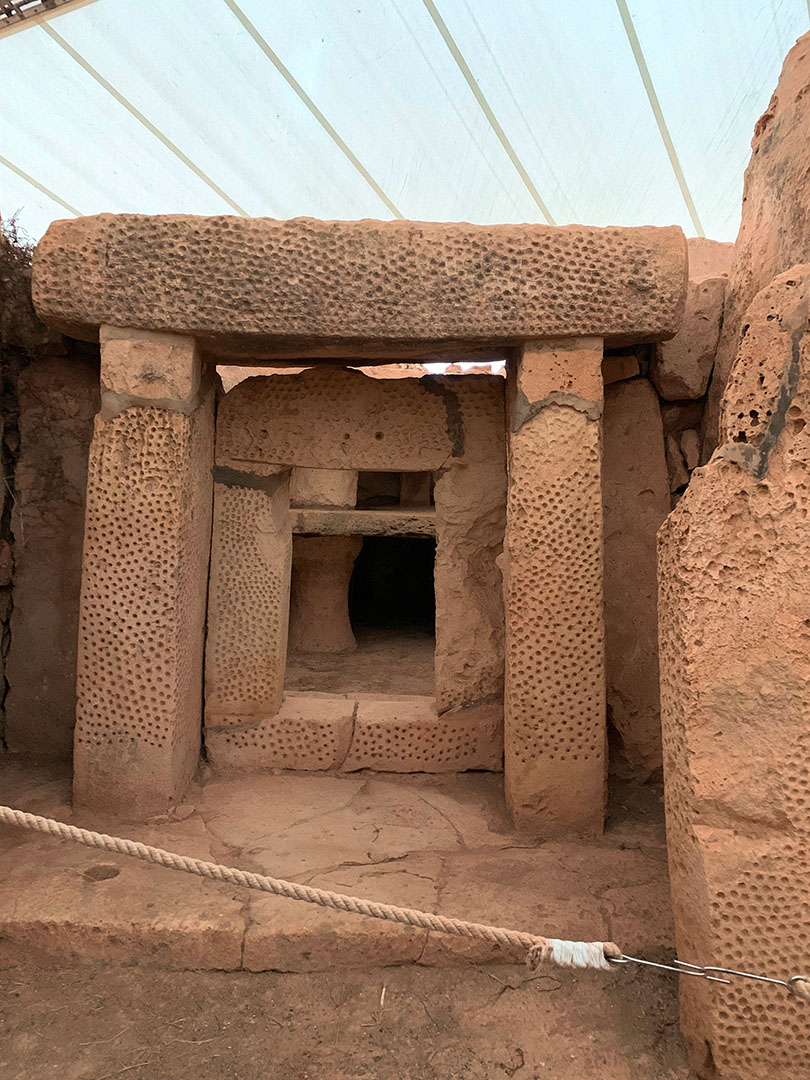 Deeply pecked patterns in side chamber inside Mnajdra Temple.