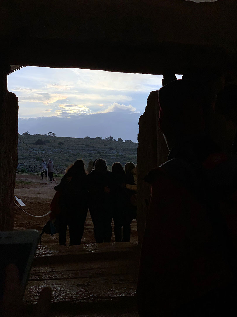 Inside Mnajdra Temple, looking out toward the spring equinox sun rising from behind the hill.