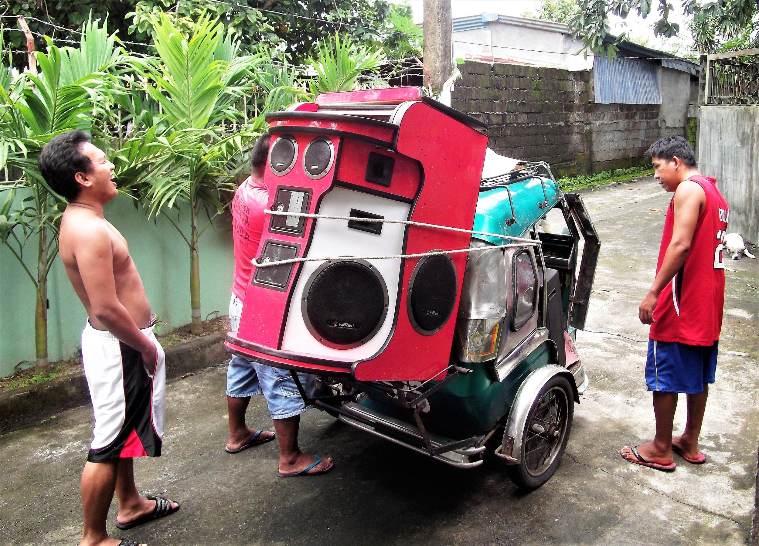 A karaoke machine on a trike.