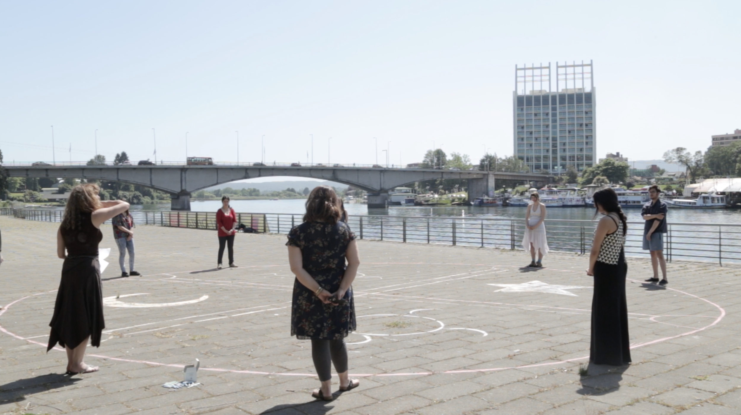 Judith did an art performance, with the students, drawing a gigantic kultrun on the boardwalk by the Calle Calle river
