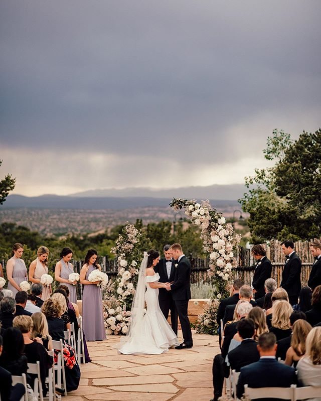 Santa Fe ceremony design by @emilyclarkeevents and @julianleaver Couldn't believe how gracefully they handled the changing weather.