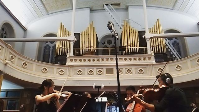 "A little while back, I saw @granitetoglass at a @sofarnyc show and knew right away I wanted to somehow work with them. Not long after, they reached out and asked me to produce their next single, funny how it goes sometimes. • • Here's some stuff from string tracking day in this gorgeous, super reverberant church⛪️🎻 • • The second vid is from the rafters which sounded bananas crazy cool. The last photo is my, ""I'm too sexy for my click"" pose.😇"